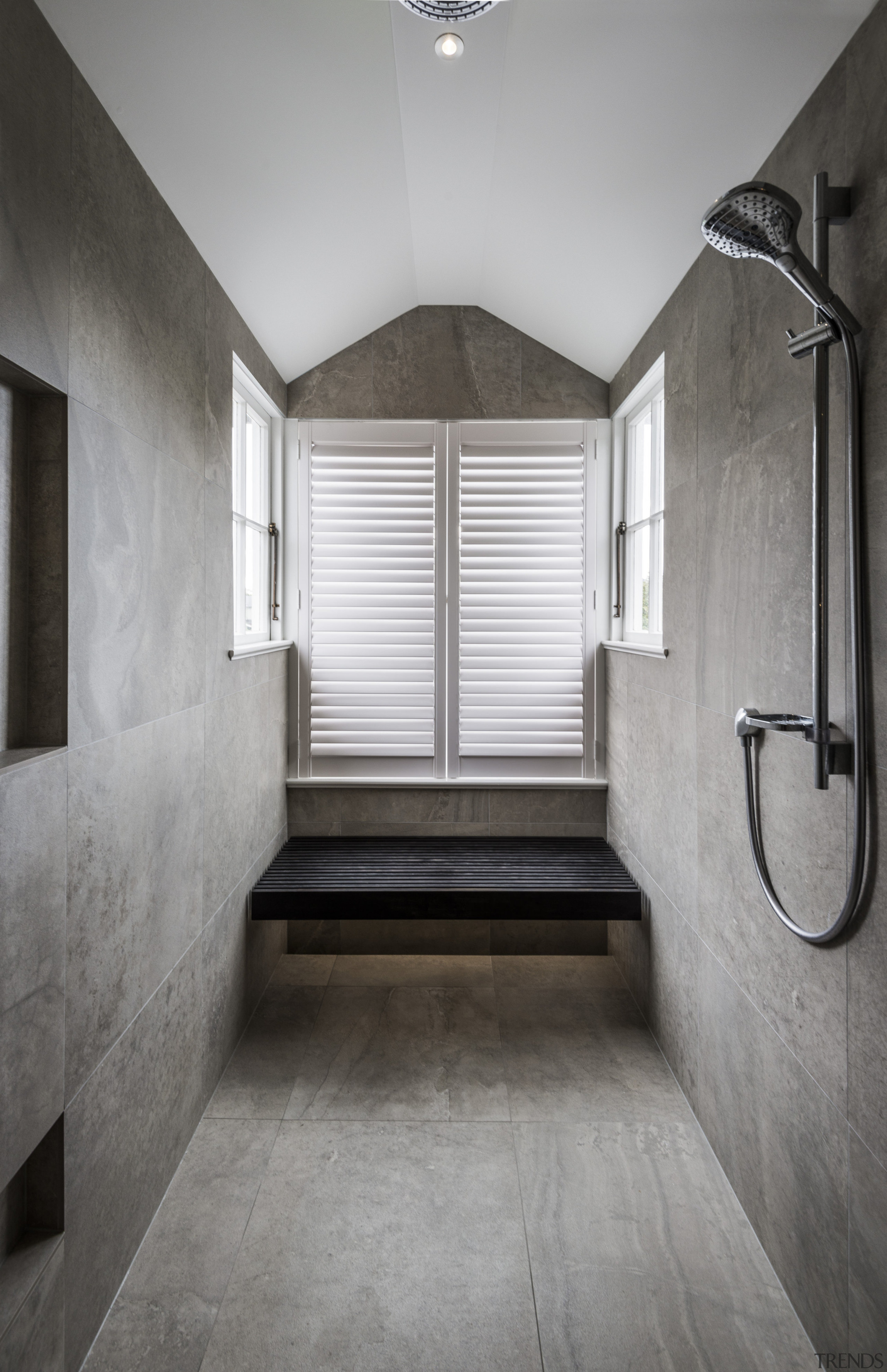 In this under-eaves bathroom, a new double shower architecture, bathroom, ceiling, daylighting, estate, floor, flooring, home, house, interior design, room, tile, gray