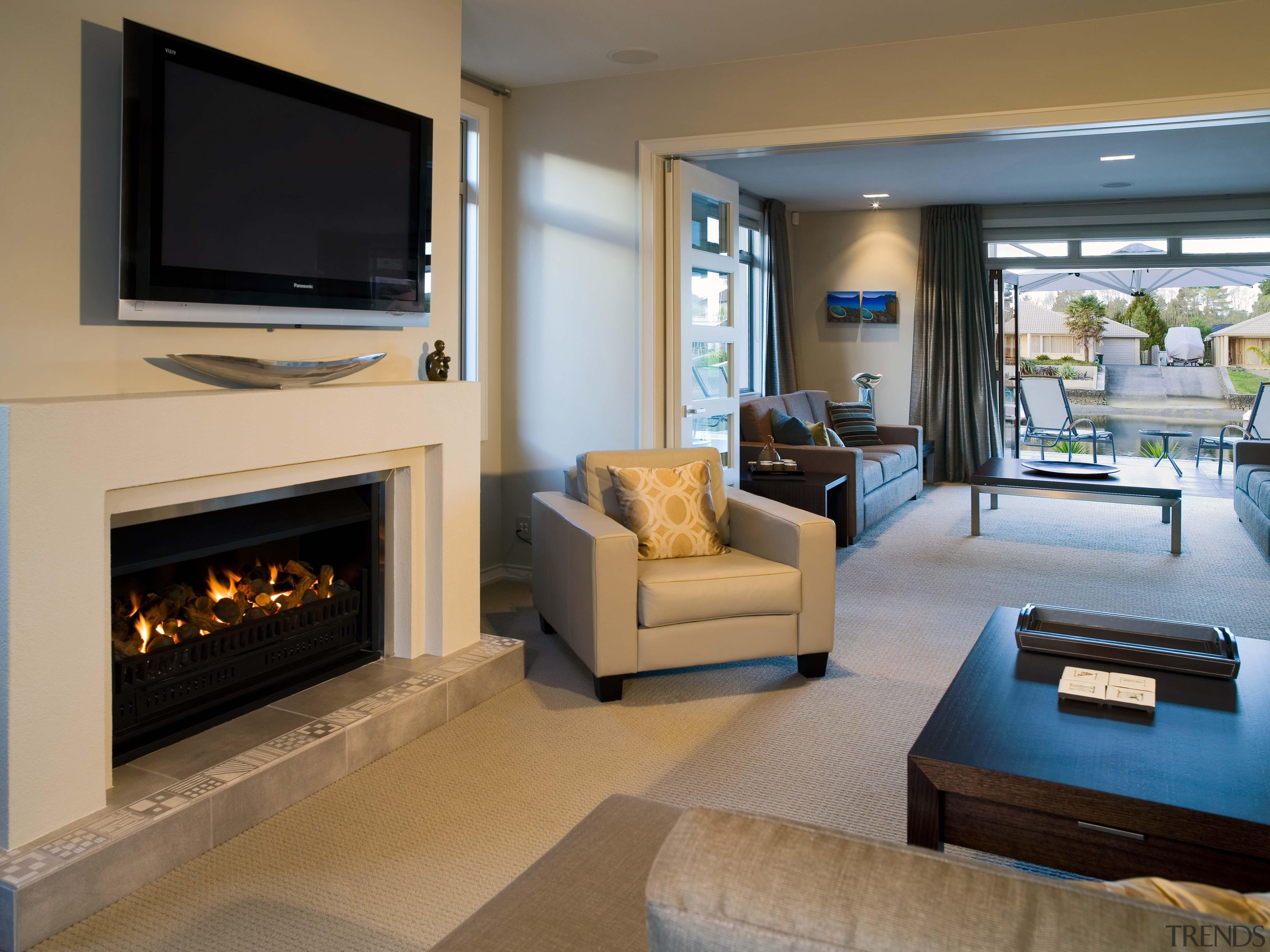 pauanui  lounge 2 - pauanui__lounge_2 - fireplace fireplace, floor, hearth, home, interior design, living room, property, real estate, room, brown