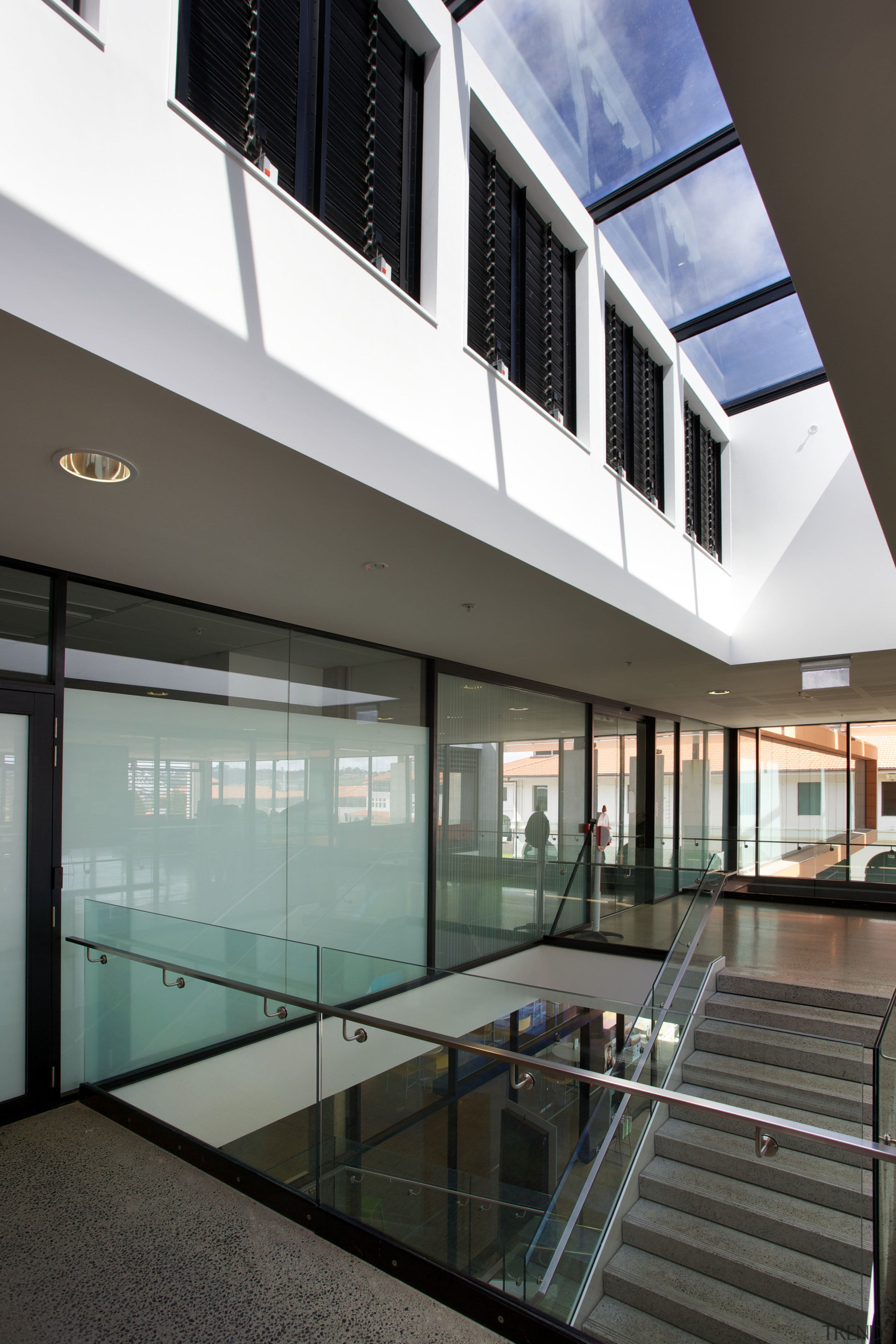 The clean-lined architecure of the facility is matched apartment, architecture, building, condominium, daylighting, glass, house, interior design, real estate, window, gray, black