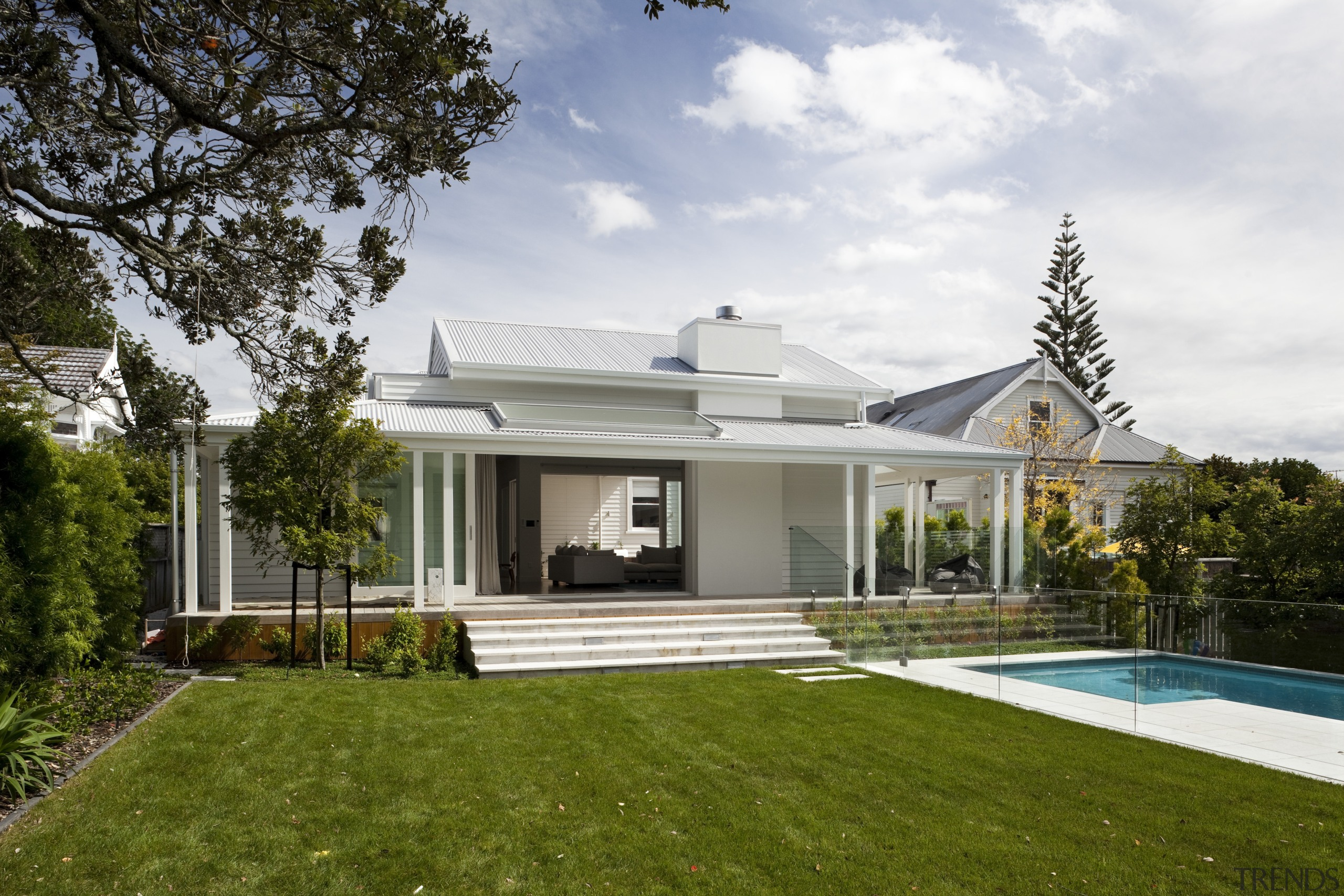 Exterior with pool and lawn. - Renovated and architecture, backyard, cottage, elevation, estate, facade, farmhouse, home, house, mansion, property, real estate, residential area, roof, villa, white, brown