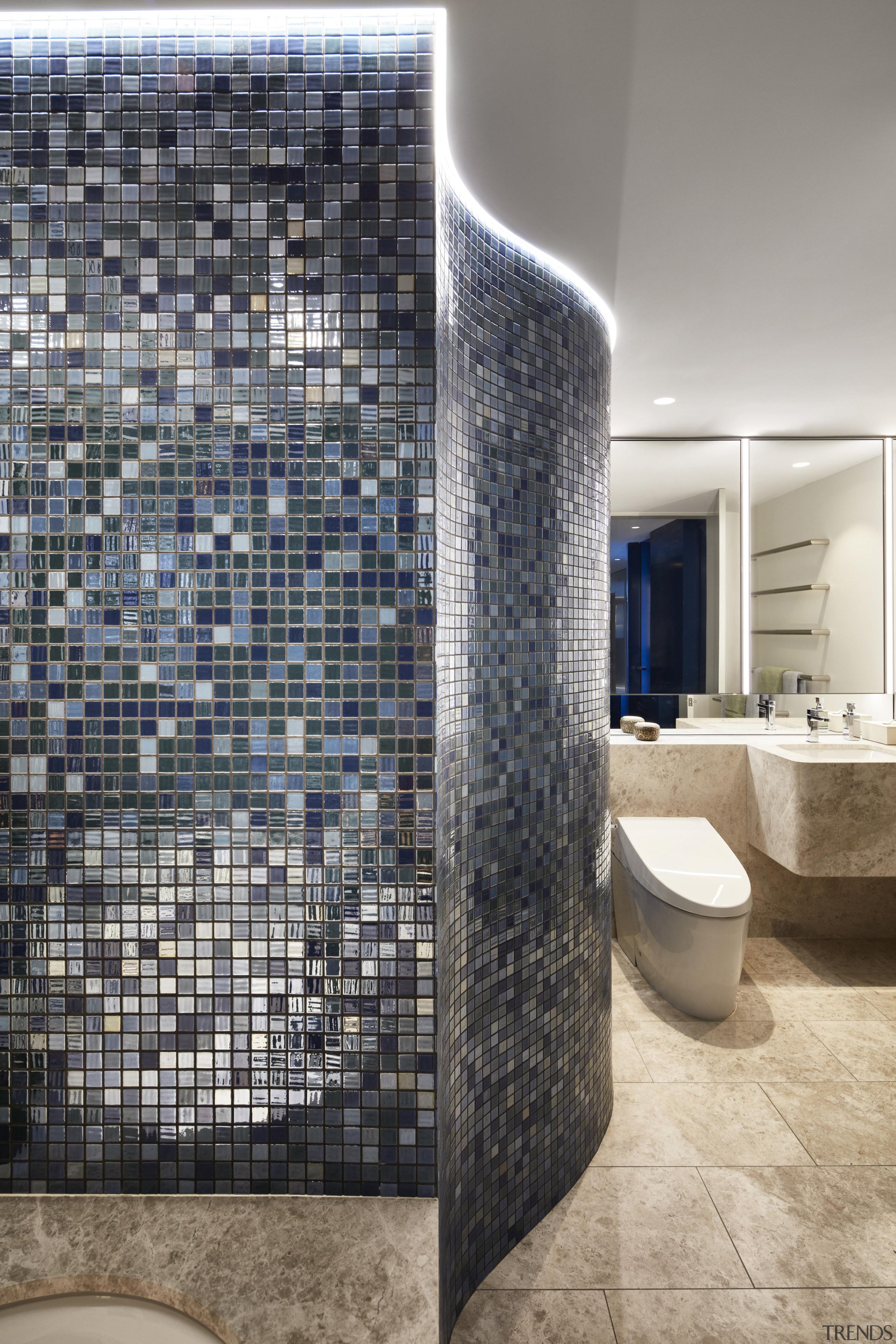 This bathroom features a blue-metallic mosaic wall and architecture, bathroom, ceramics, floor, flooring, apartment, interior design, mosaic, tile, wall, gray, Archer Design