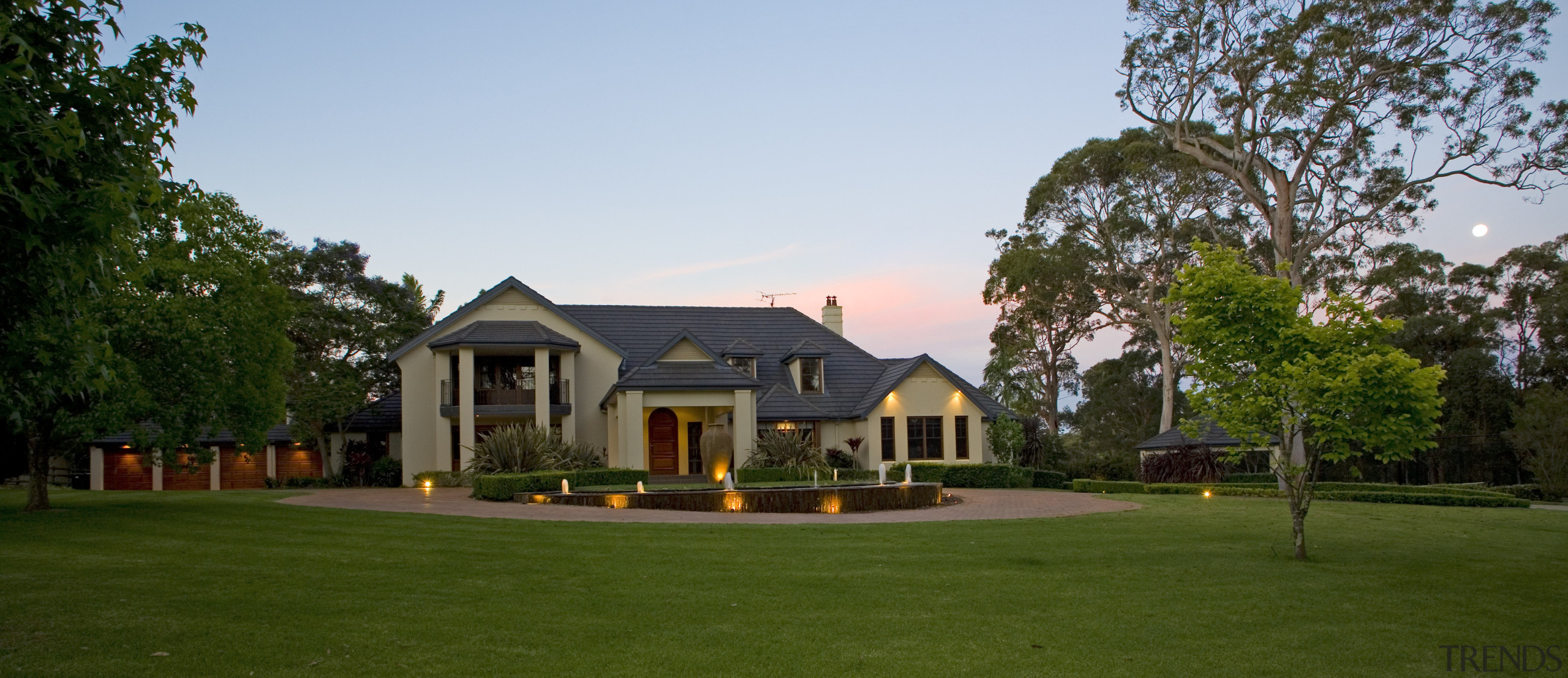 Exterior view of a home which was designed backyard, cottage, estate, farmhouse, grass, home, house, land lot, landscape, landscaping, lawn, mansion, plantation, property, real estate, residential area, suburb, tree, villa, yard, brown