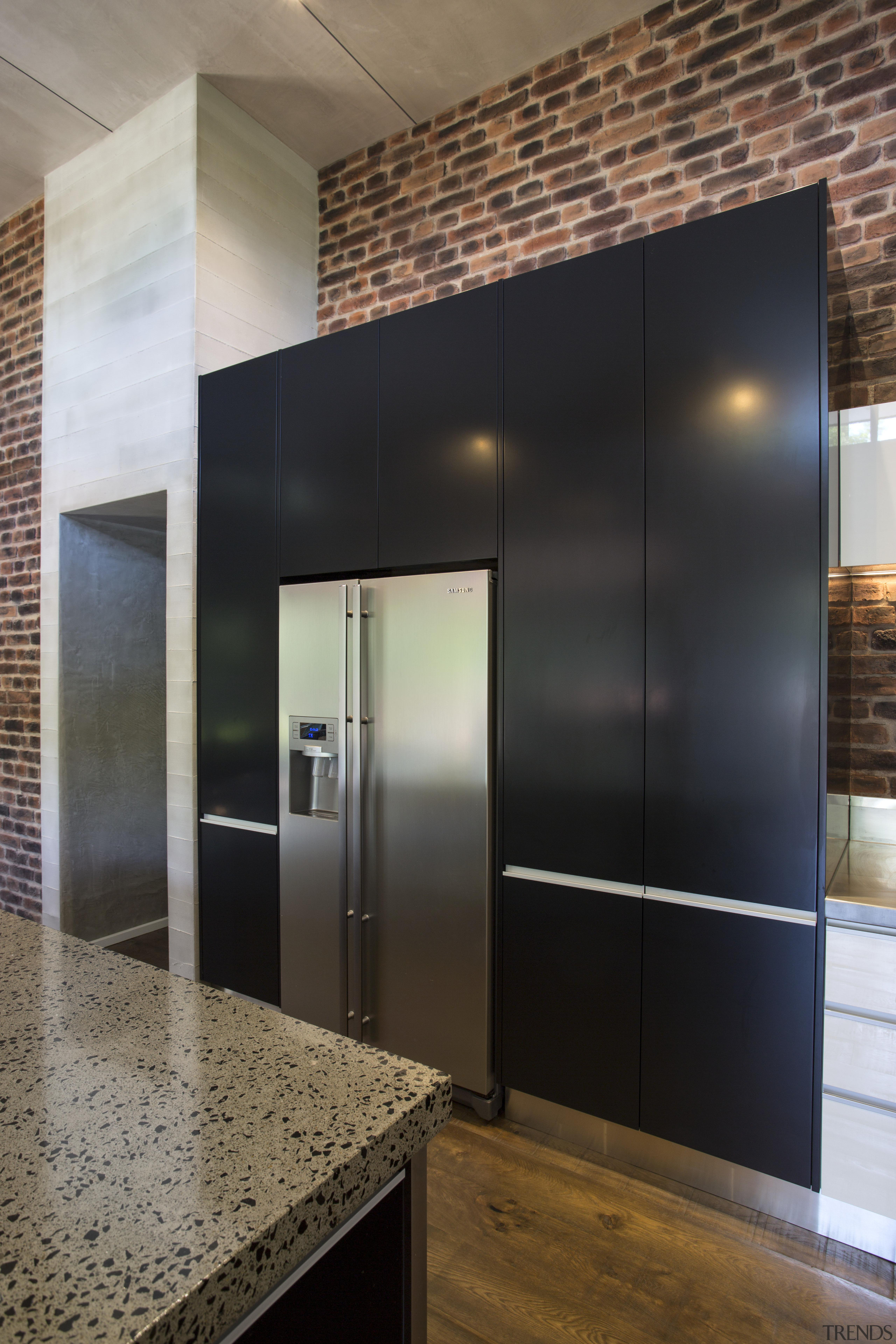 This wall of kitchen cabinetry includes a Hafele architecture, cabinetry, ceiling, countertop, floor, flooring, interior design, wall, wood flooring, black