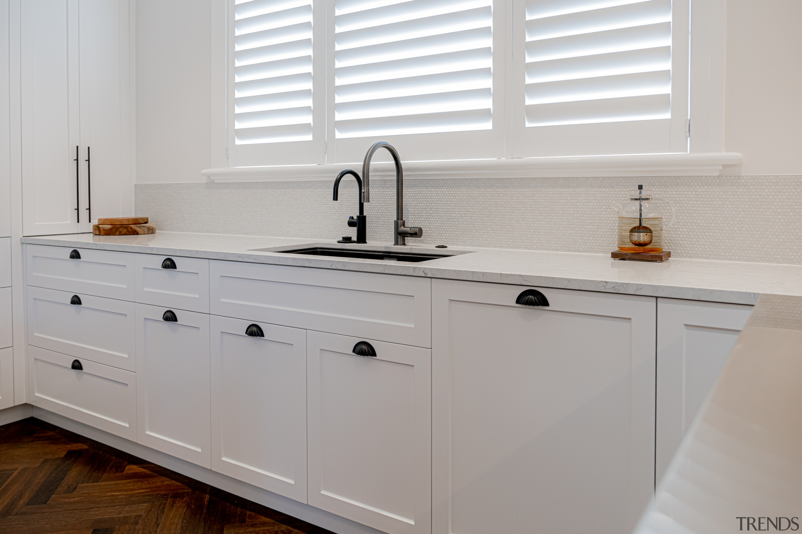 The sun coming through the existing sink windows