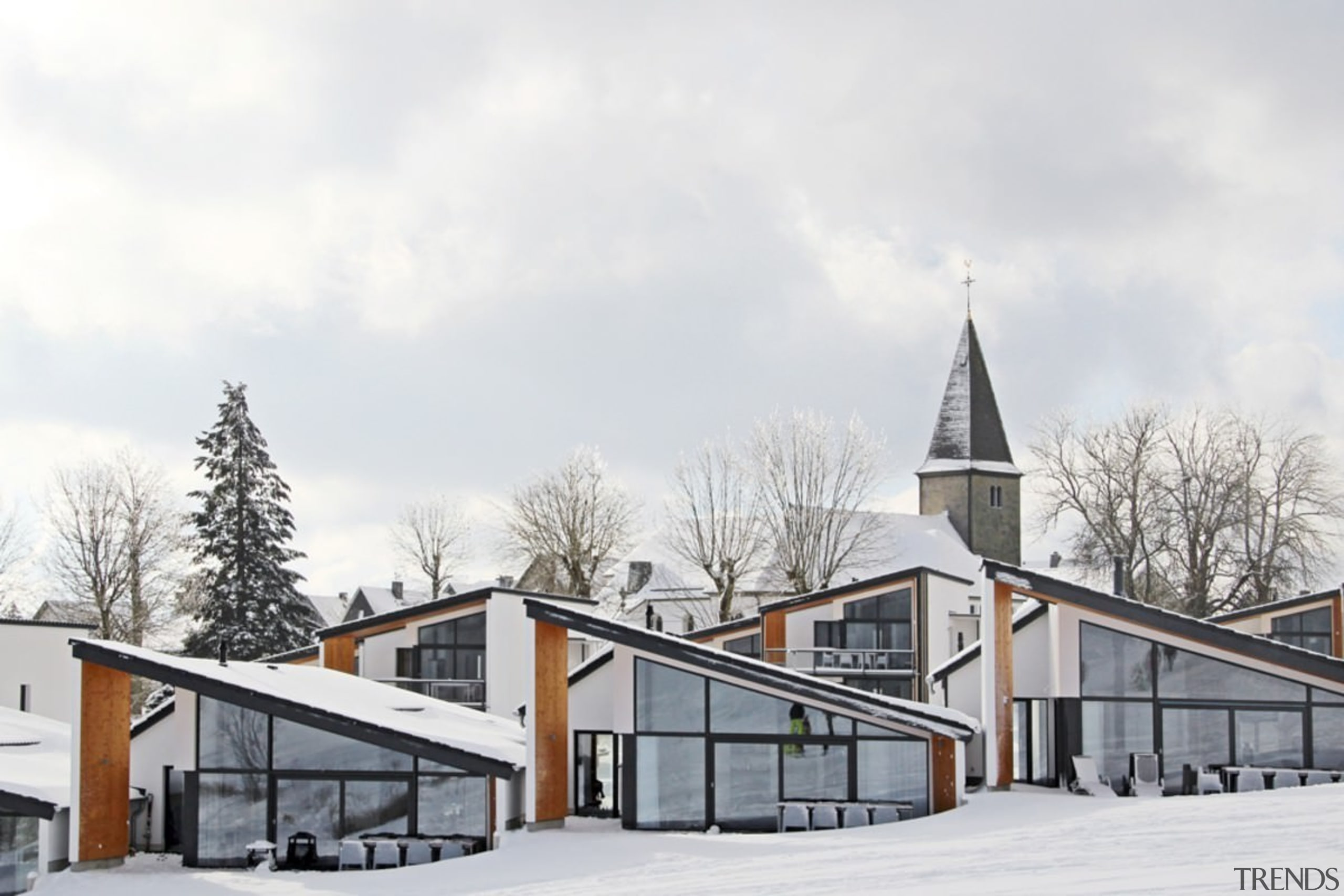 A view of the villas in winter - architecture, building, facade, home, house, property, real estate, residential area, sky, snow, winter, white
