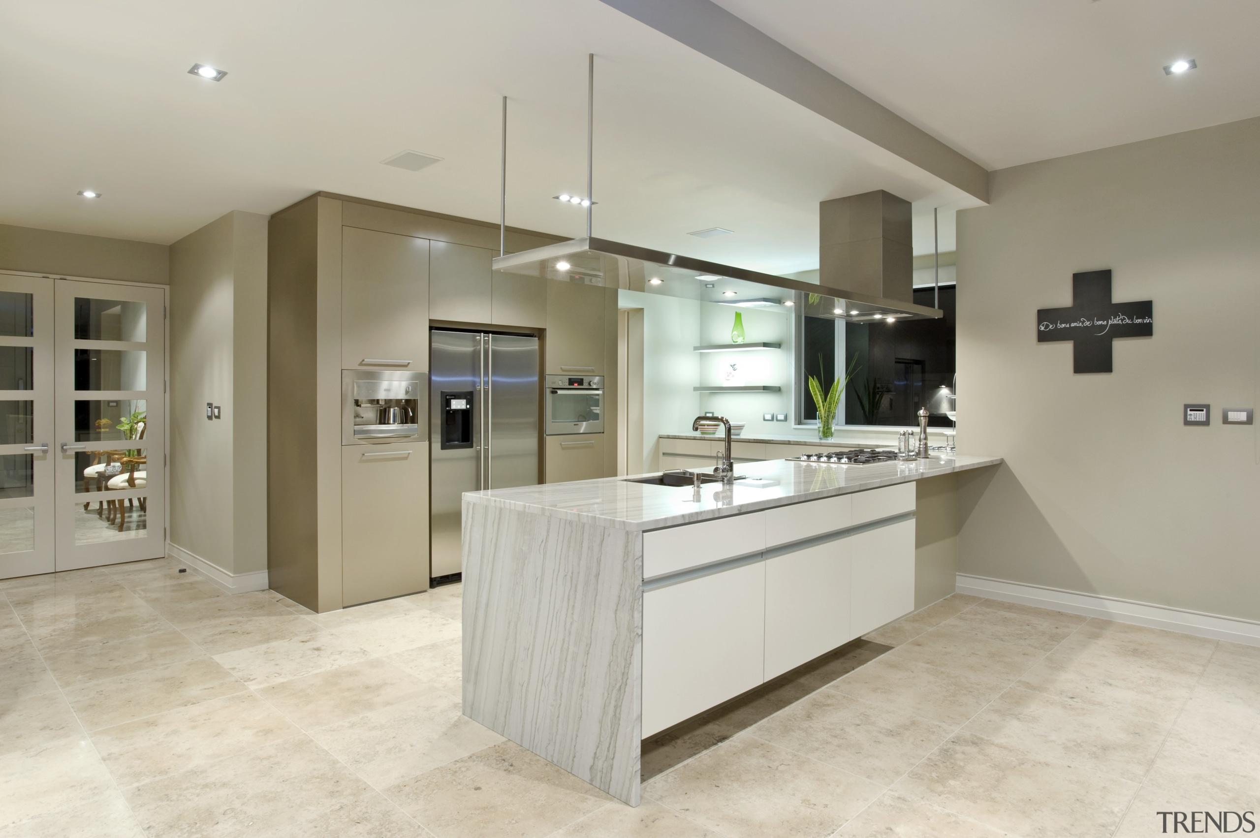 The kitchen, manufactured by Fyfe kitchens, is equipped cabinetry, countertop, floor, flooring, interior design, kitchen, laminate flooring, real estate, room, tile, wood flooring, gray