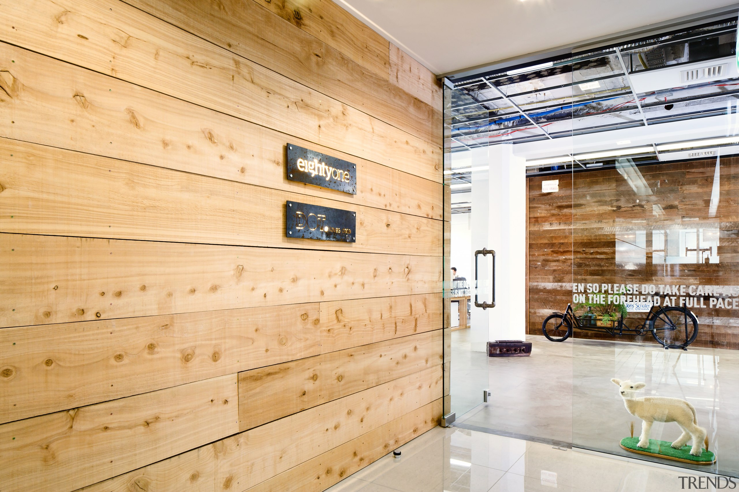 A glass entry door, untreated wood surfaces and architecture, floor, flooring, interior design, real estate, wall, wood, orange, white