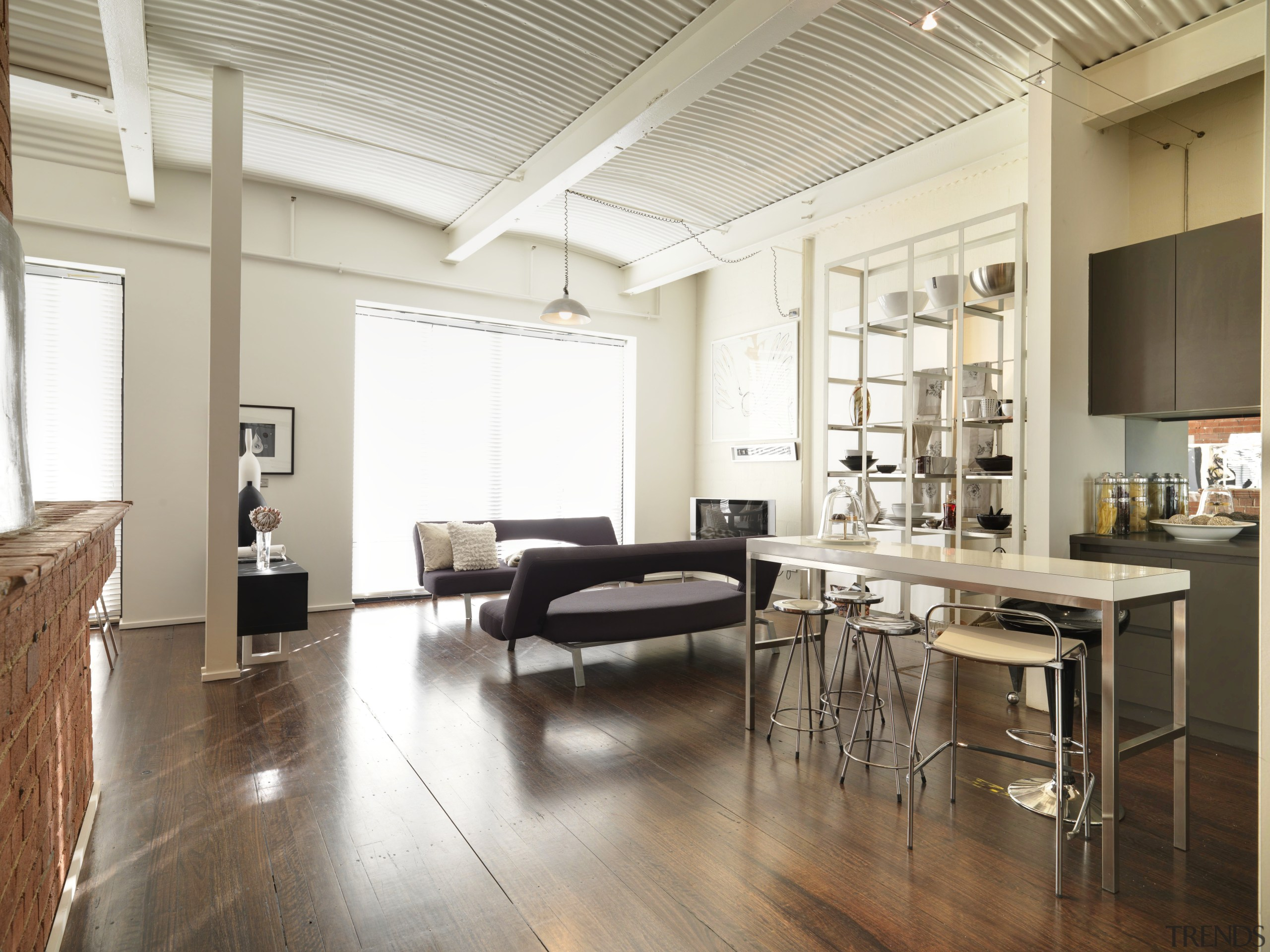 View of open-plan living and kitchen area with ceiling, floor, flooring, hardwood, interior design, laminate flooring, living room, loft, real estate, wood, wood flooring, white, brown