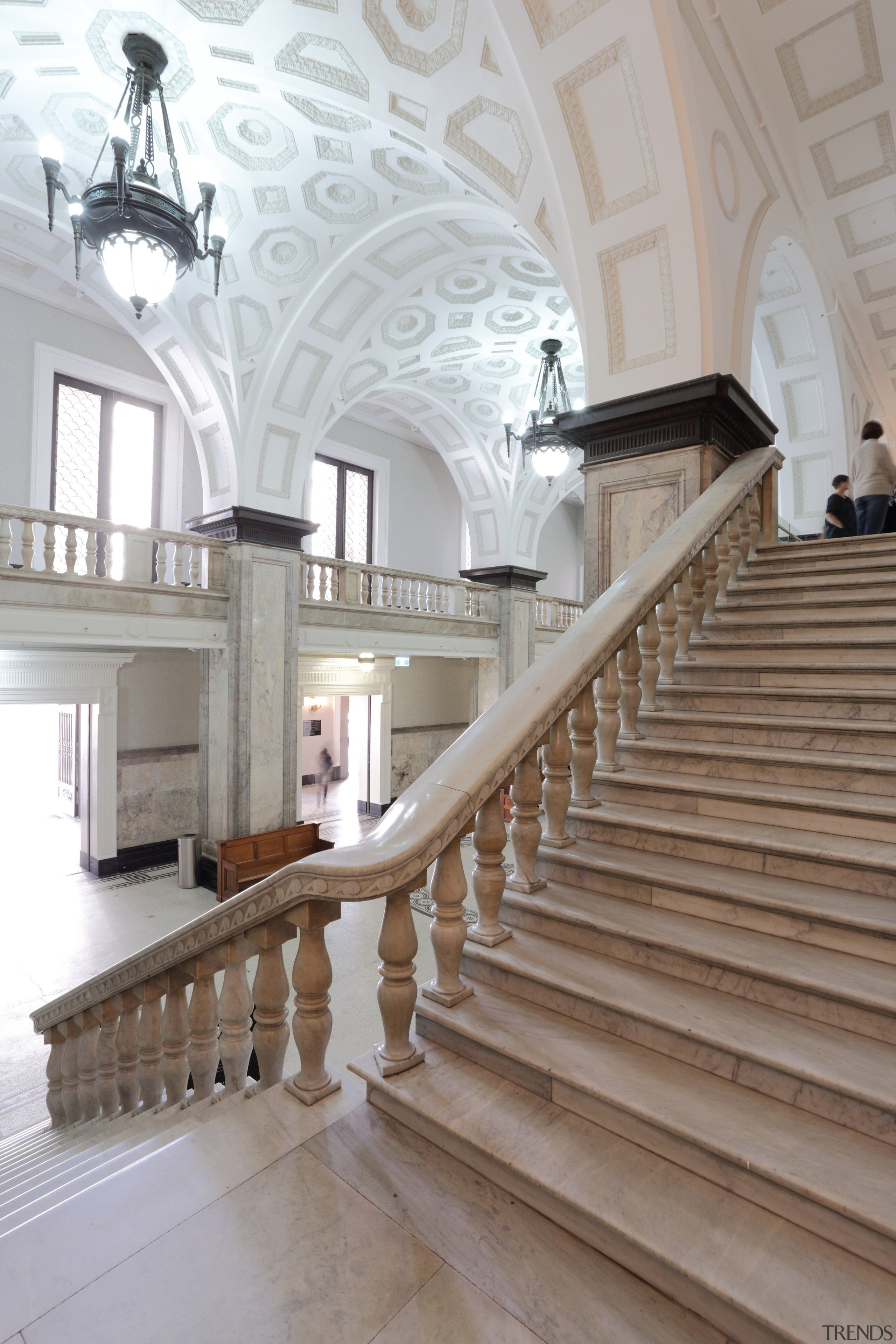 The grand King George Square entry is one architecture, baluster, building, ceiling, daylighting, estate, handrail, interior design, molding, stairs, structure, gray