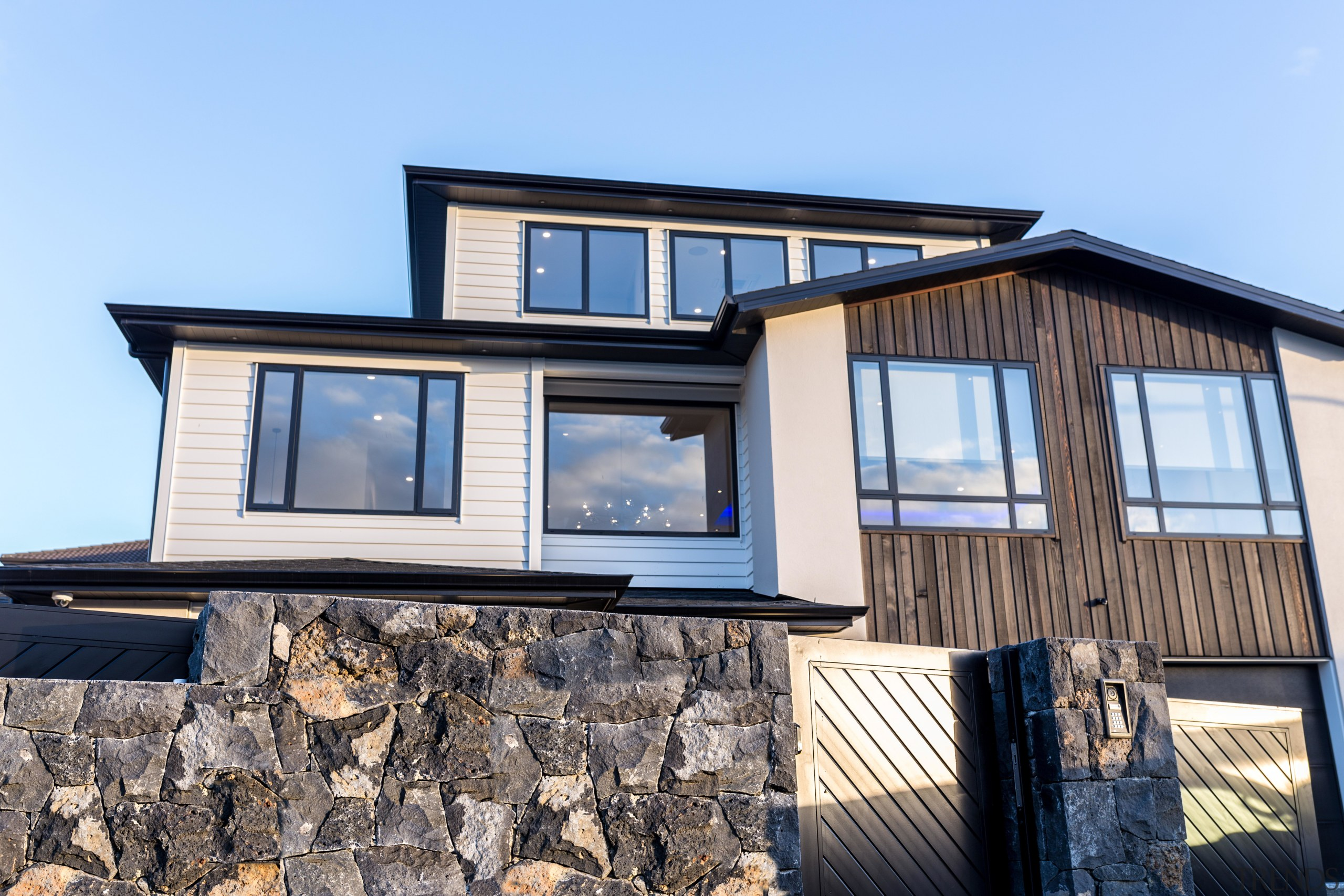 This showhome by Chancellor Construction has a dramatic home, house, property, real estate, residential area, window, Sang Architectural, Chancellor Construction, Elite North Harbour