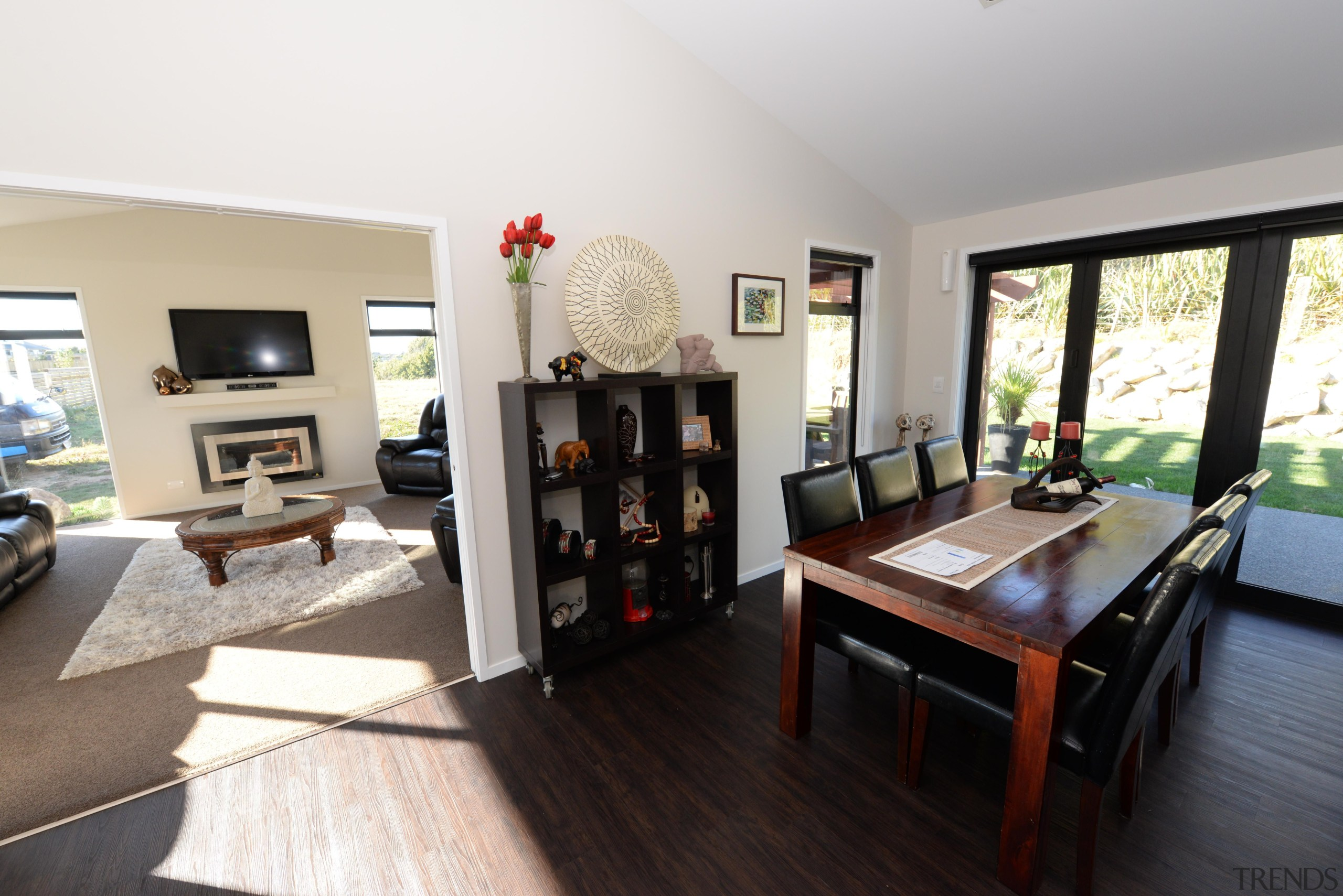 This home has a kitchen-dining area that is house, interior design, living room, property, real estate, room, white, black
