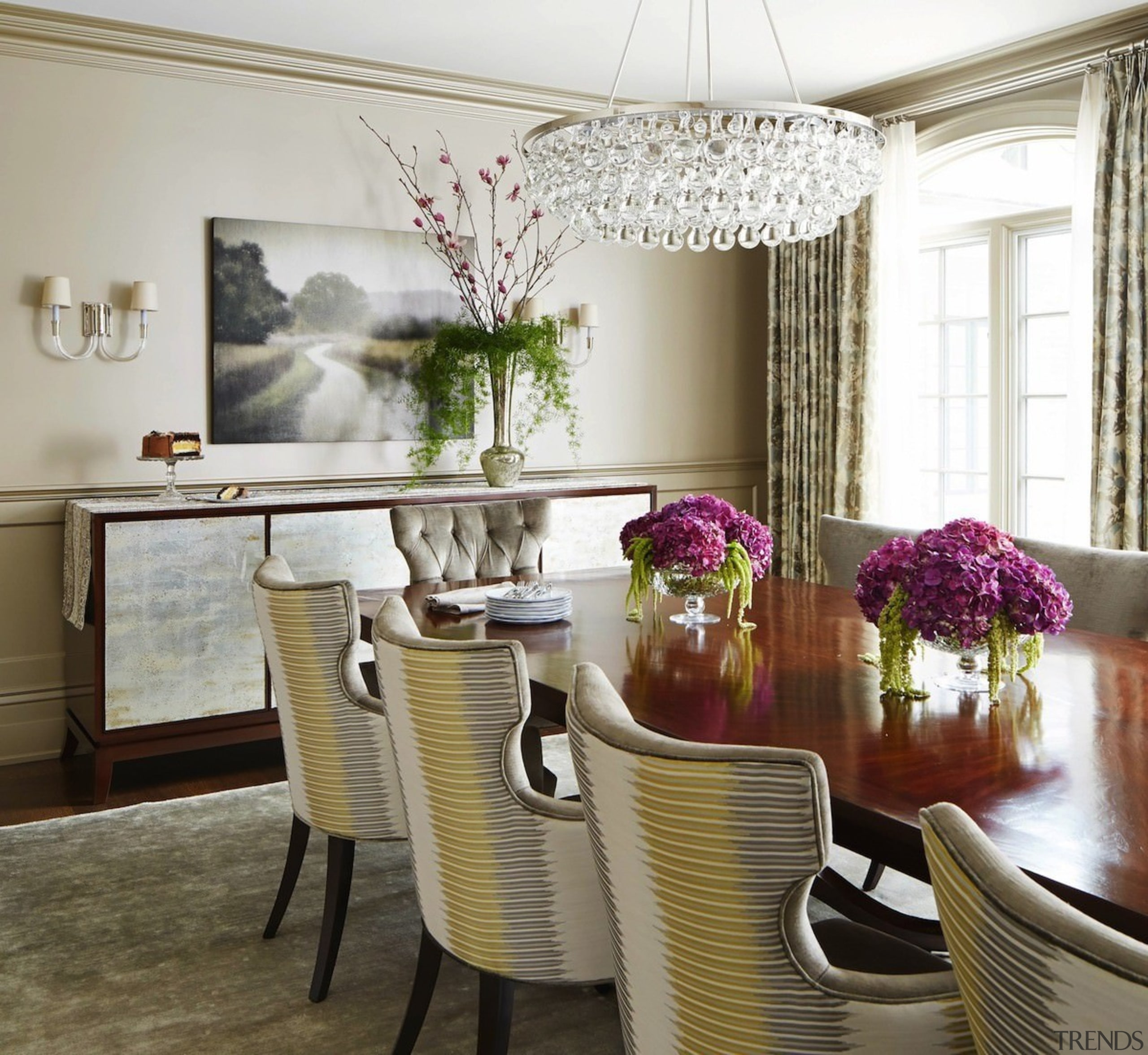 The formal dining room has a large chandelier chair, dining room, furniture, home, interior design, living room, purple, room, table, white, brown