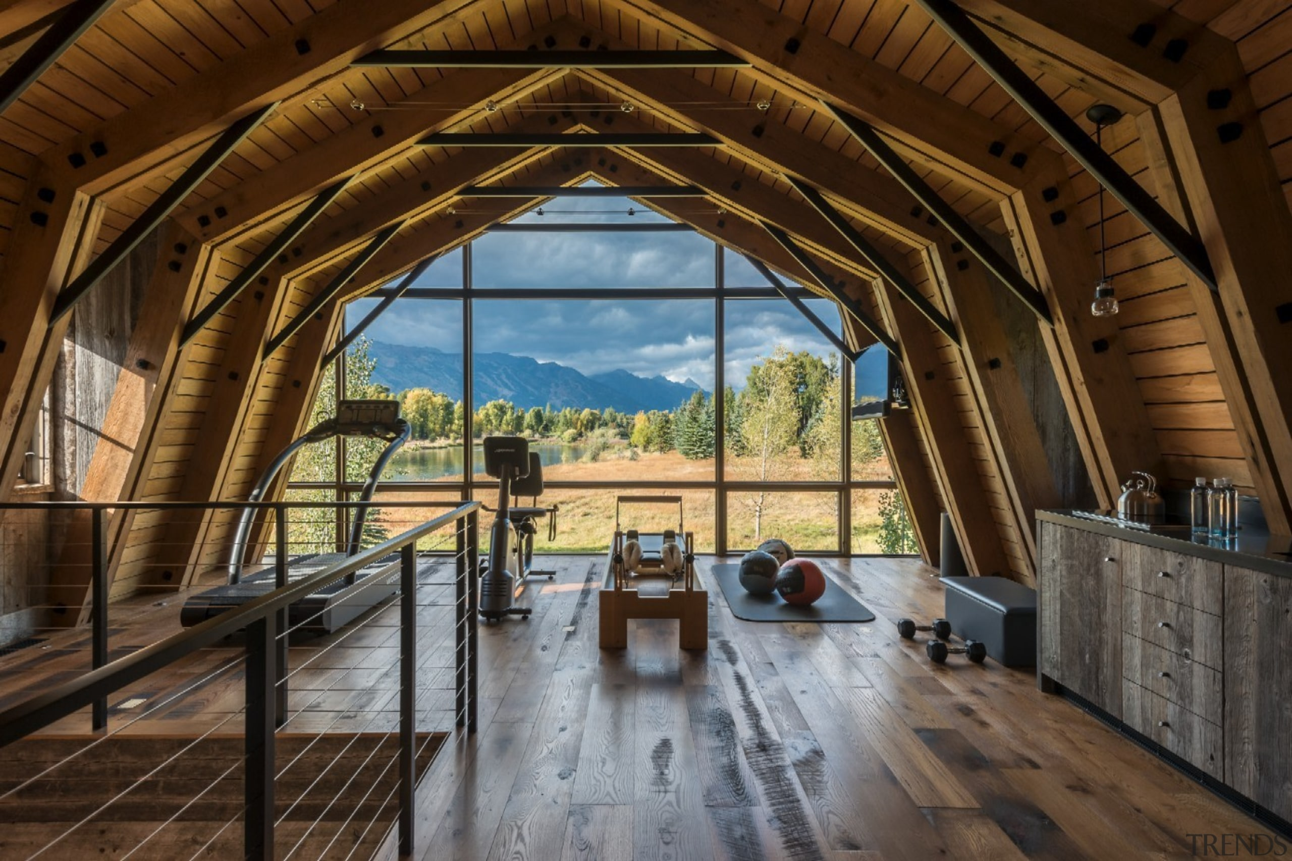 The gym on this level has a spectacular estate, home, real estate, wood, brown