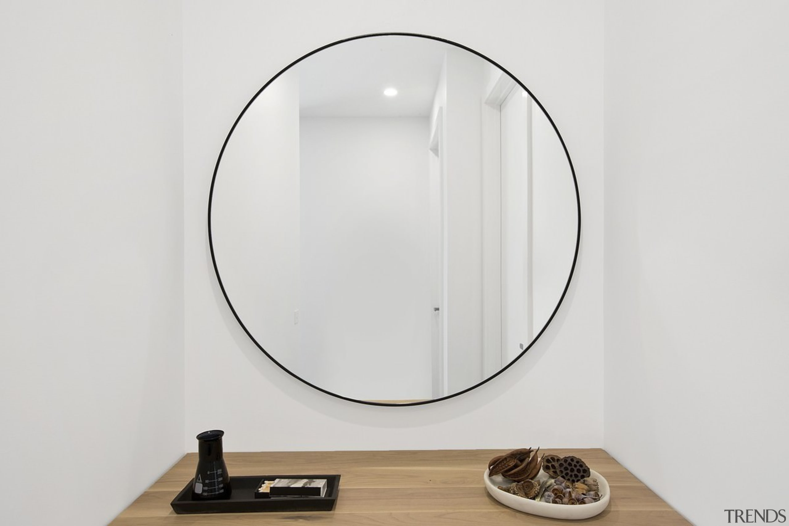 A large circular mirror provides a focal point product design, white
