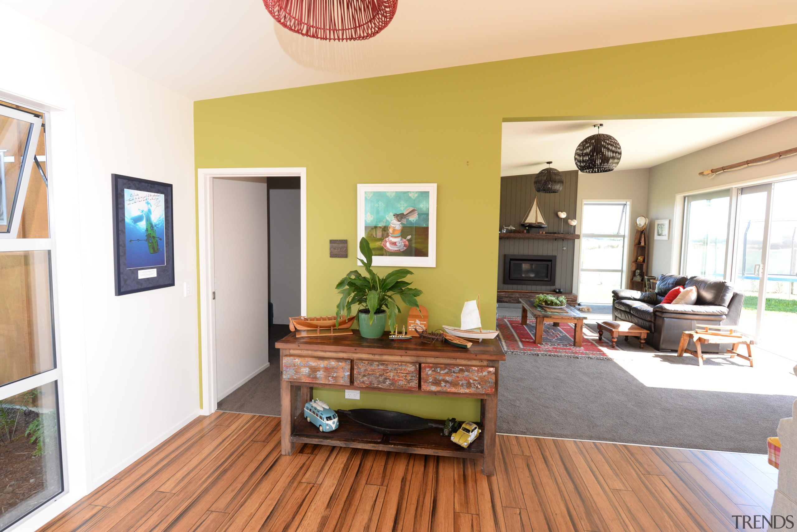 Since the early 1980's, we have successfully been floor, flooring, hardwood, home, house, interior design, living room, property, real estate, room, wood, wood flooring, white, orange