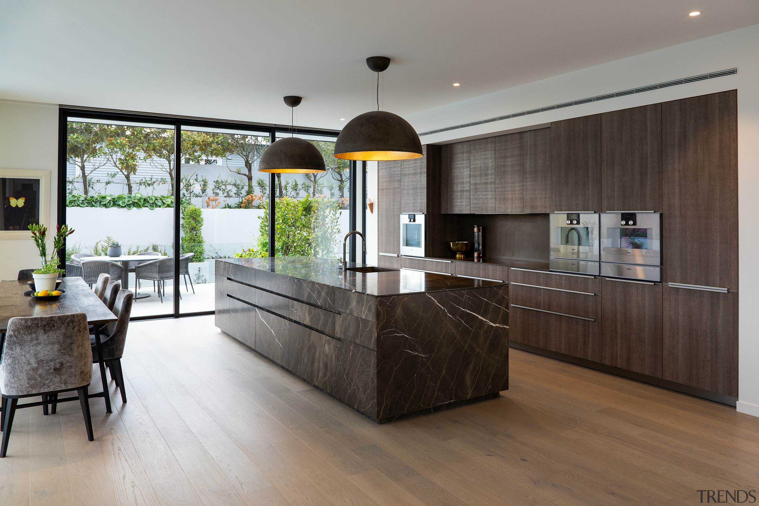 Floor to ceiling sliders adjacent to the kitchen