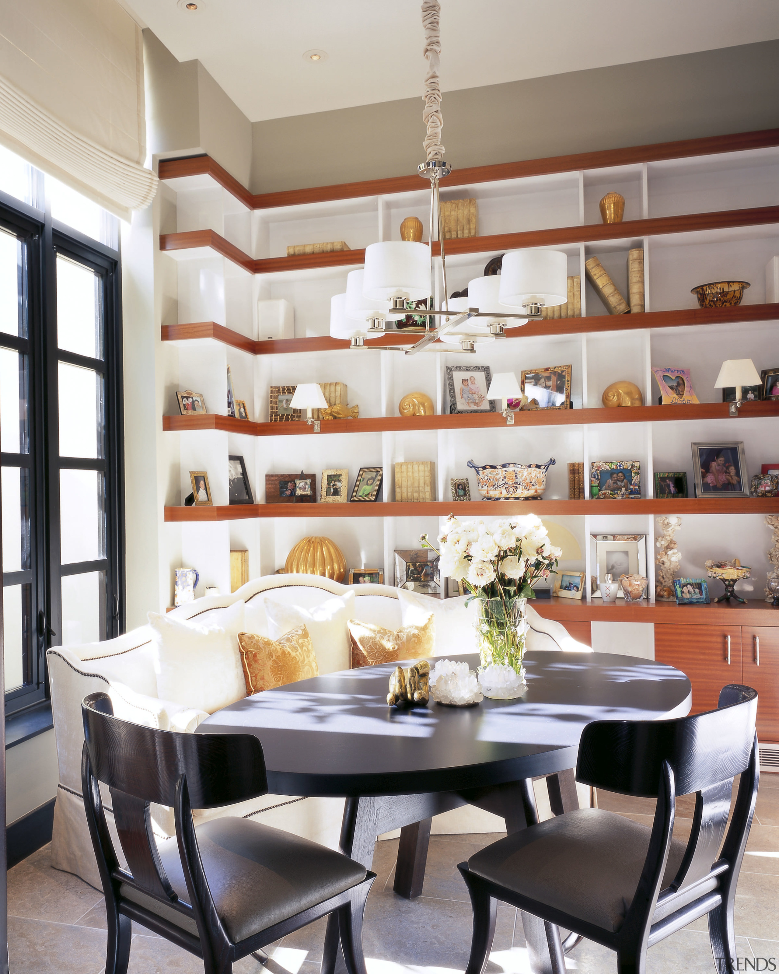 View of the breakfast area which features a dining room, furniture, interior design, room, table, gray