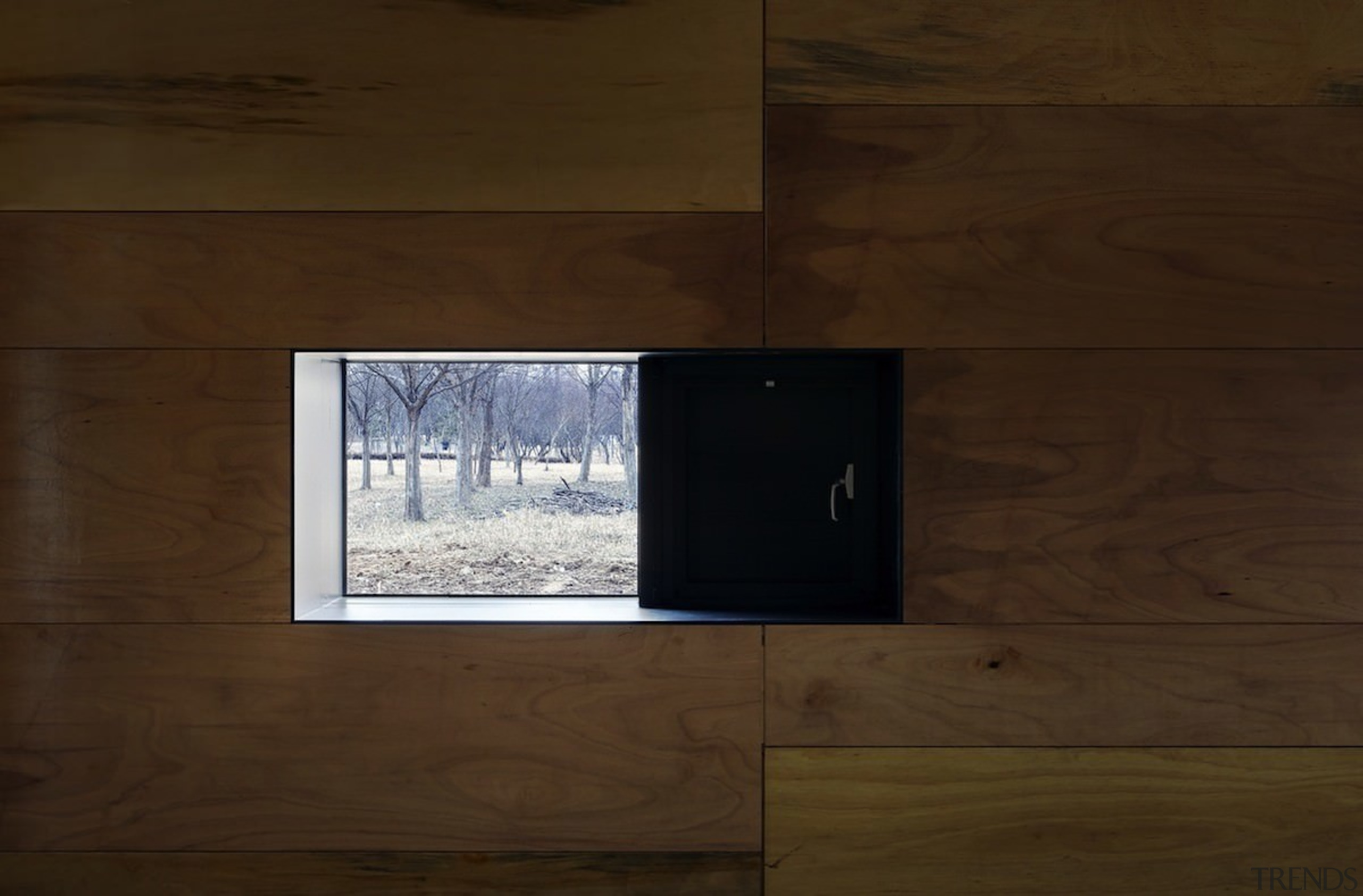 This window provides a view of the forest architecture, floor, wall, wood, wood flooring, wood stain, brown