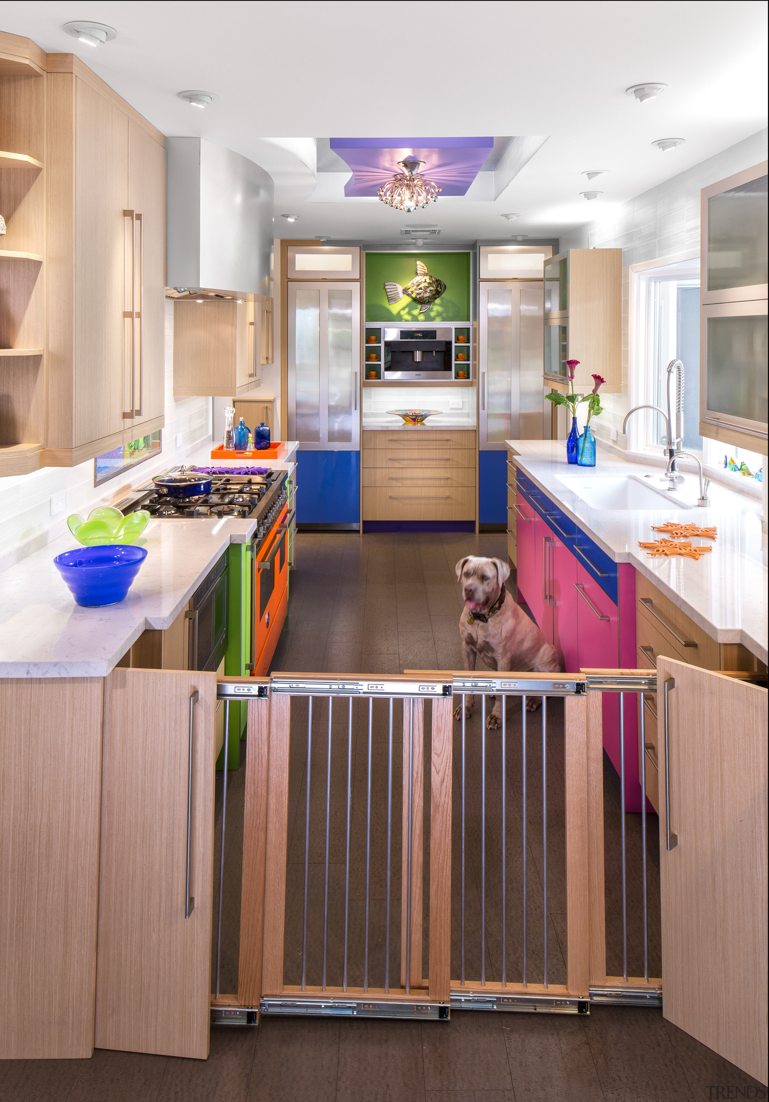 This colorful kitchen by Elina Katsioula-Beall features a cabinetry, countertop, floor, interior design, kitchen, room, white