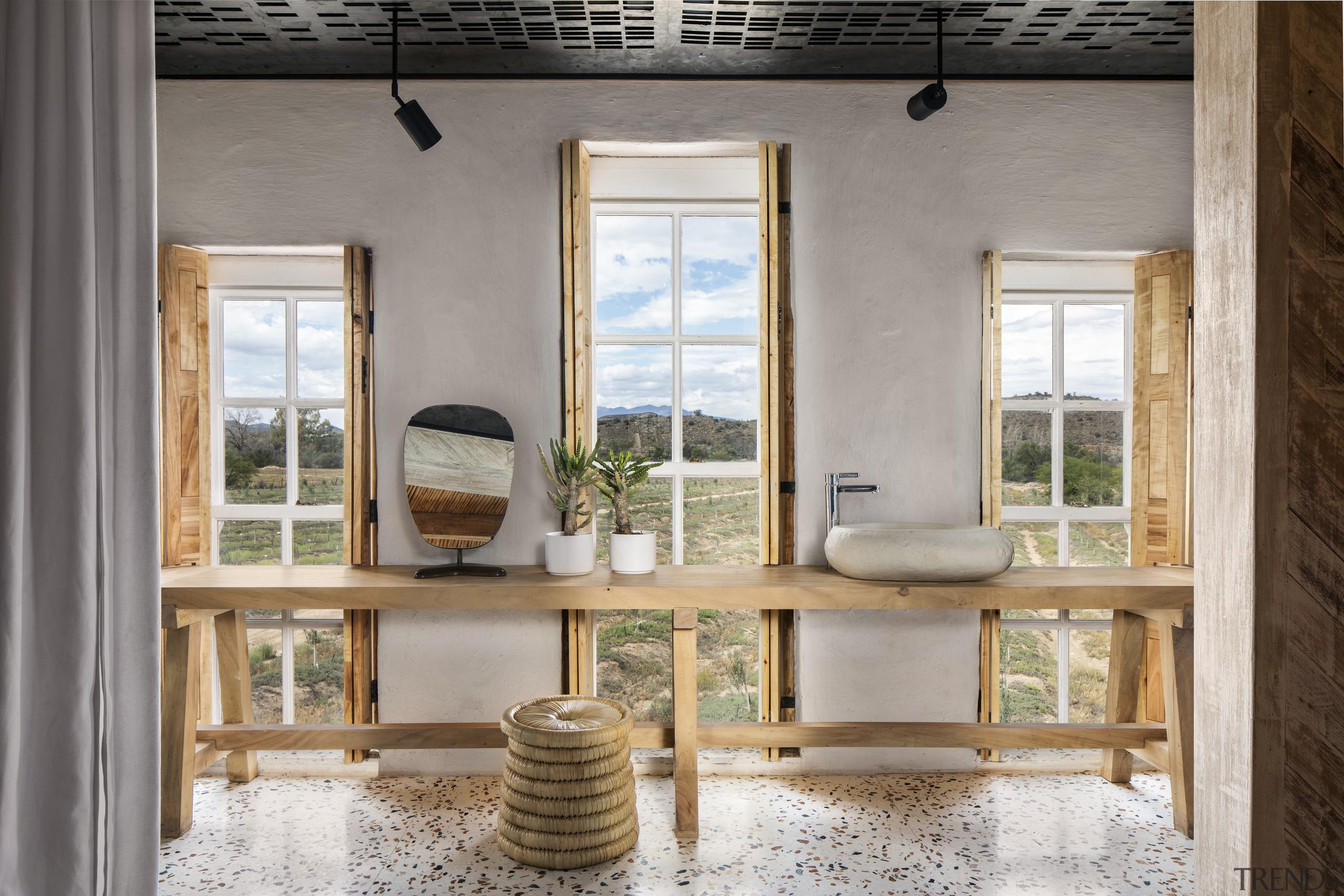 The bathroom combines contemporary materials such as terrazzo