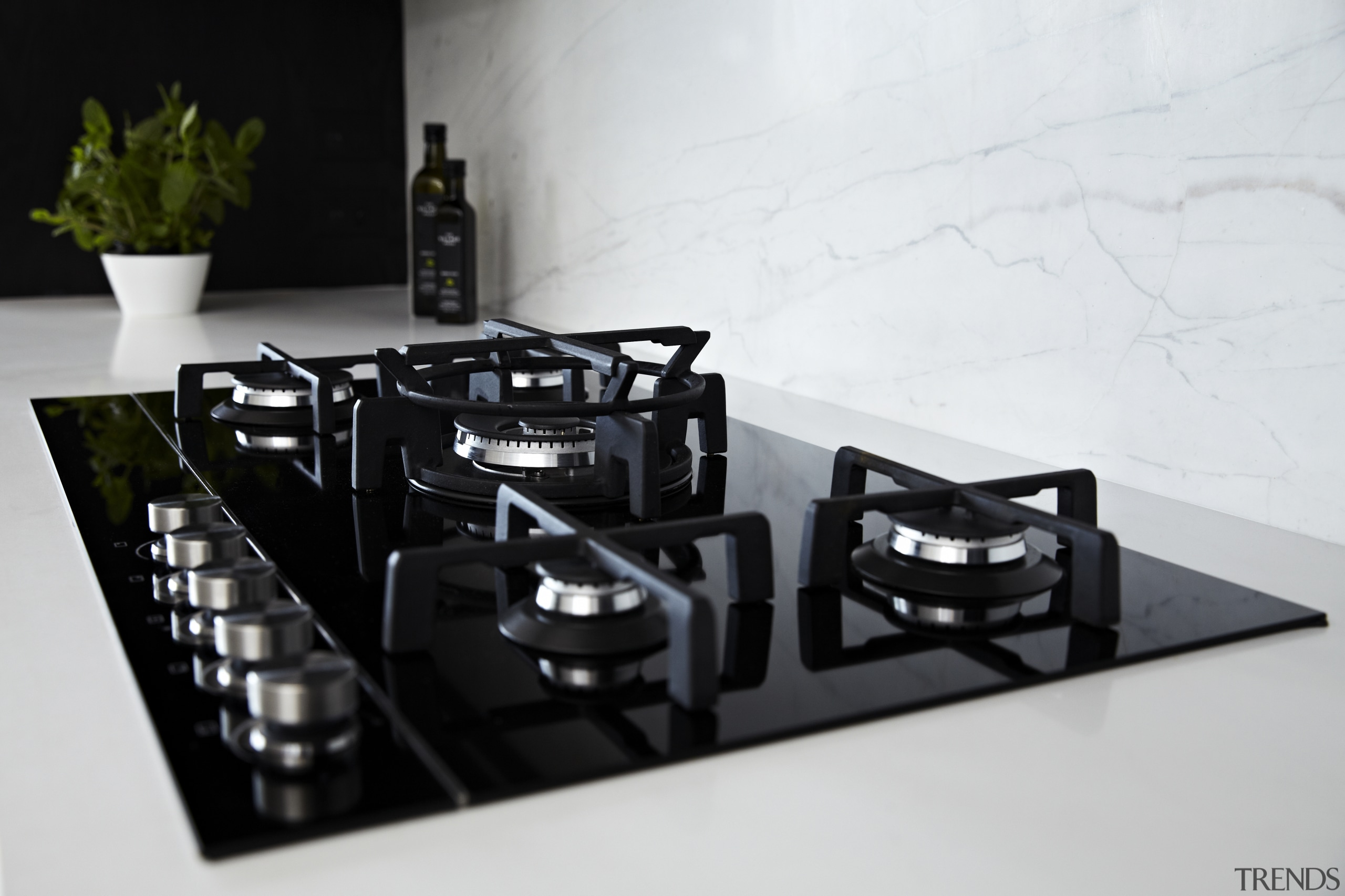 Fisher & Paykel appliances, including a gas cooktop, product, white, black