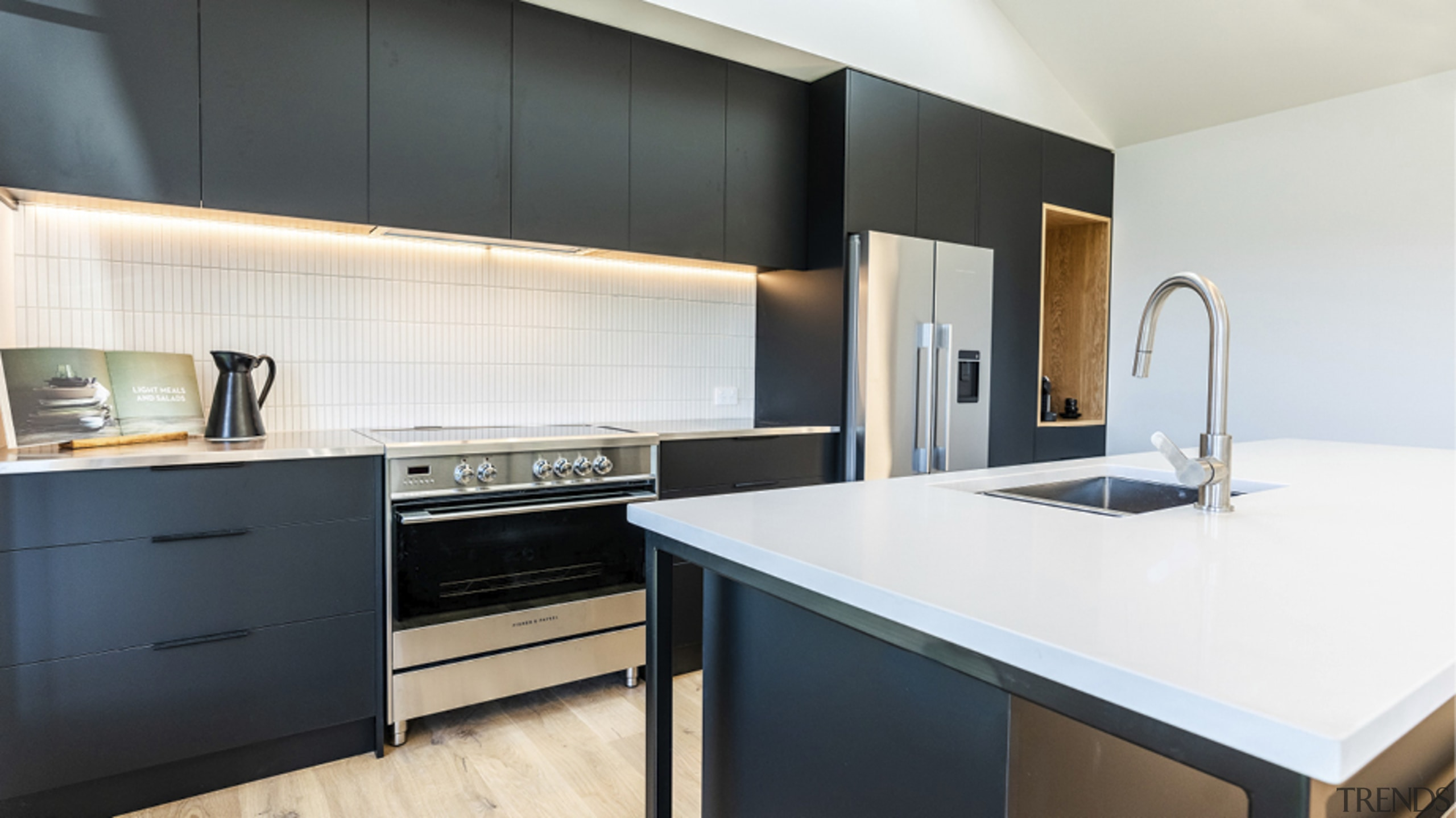 Vertical subway tiles provide a classic splashback with