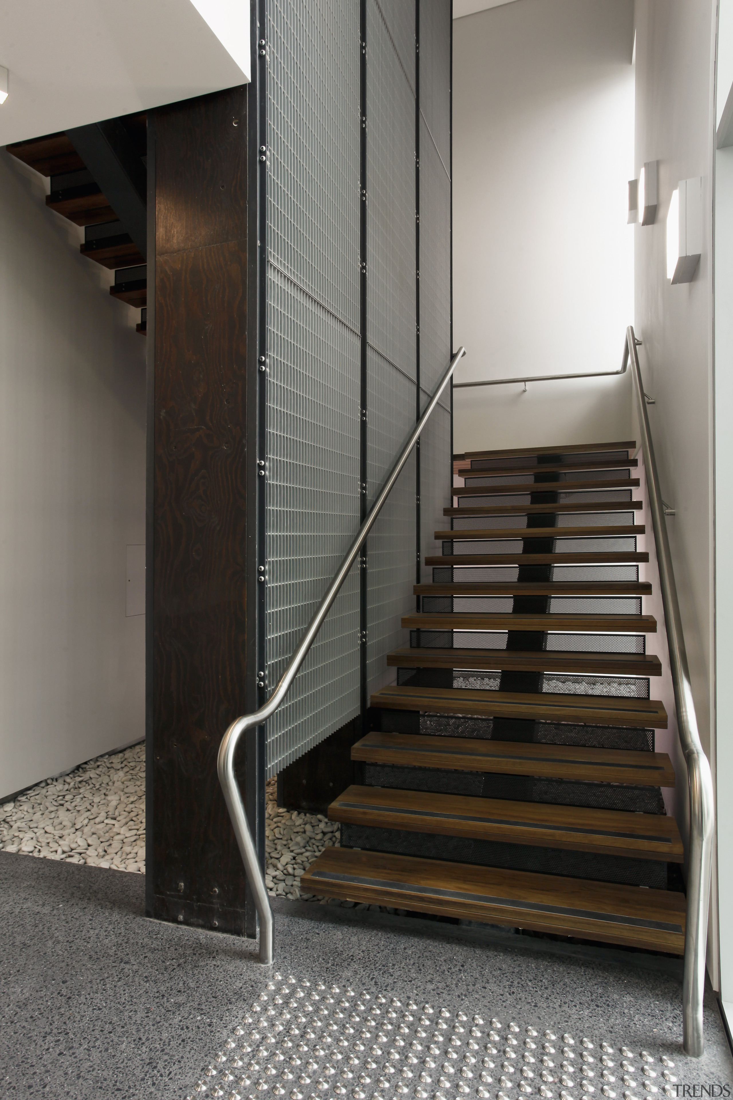 This boutique office development on a brownfields site architecture, floor, flooring, glass, handrail, interior design, stairs, wood, gray, black