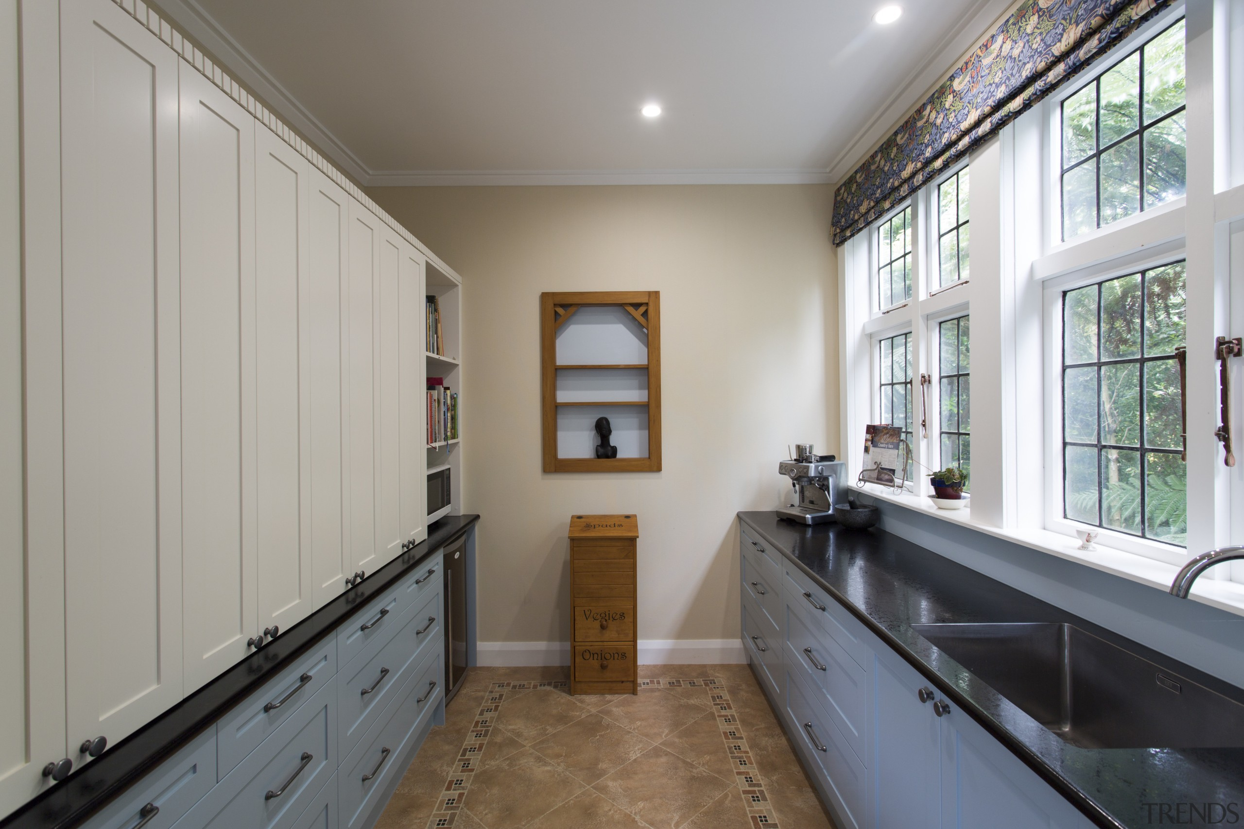 This kitchen was designed largely around the needs floor, home, house, property, real estate, room, window, wood, gray