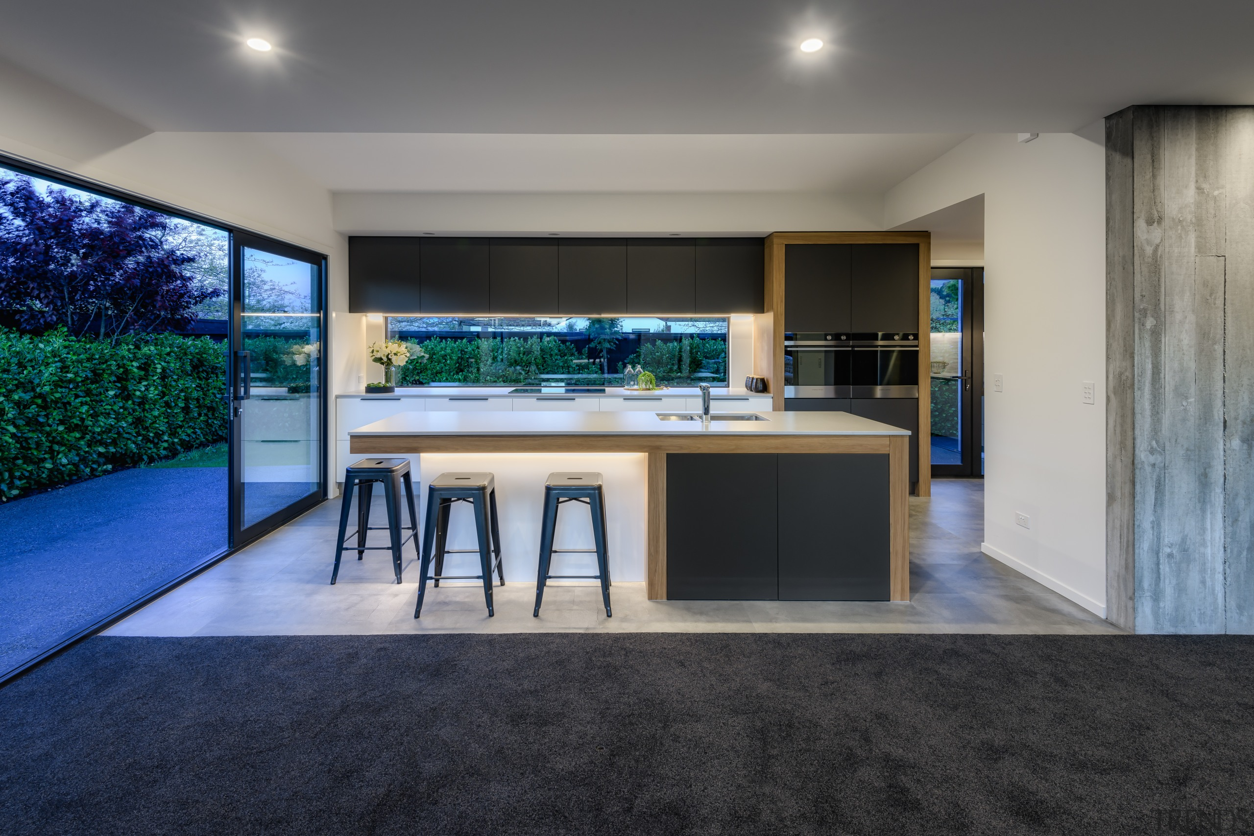 With glass slider beside and glass splashback behind,