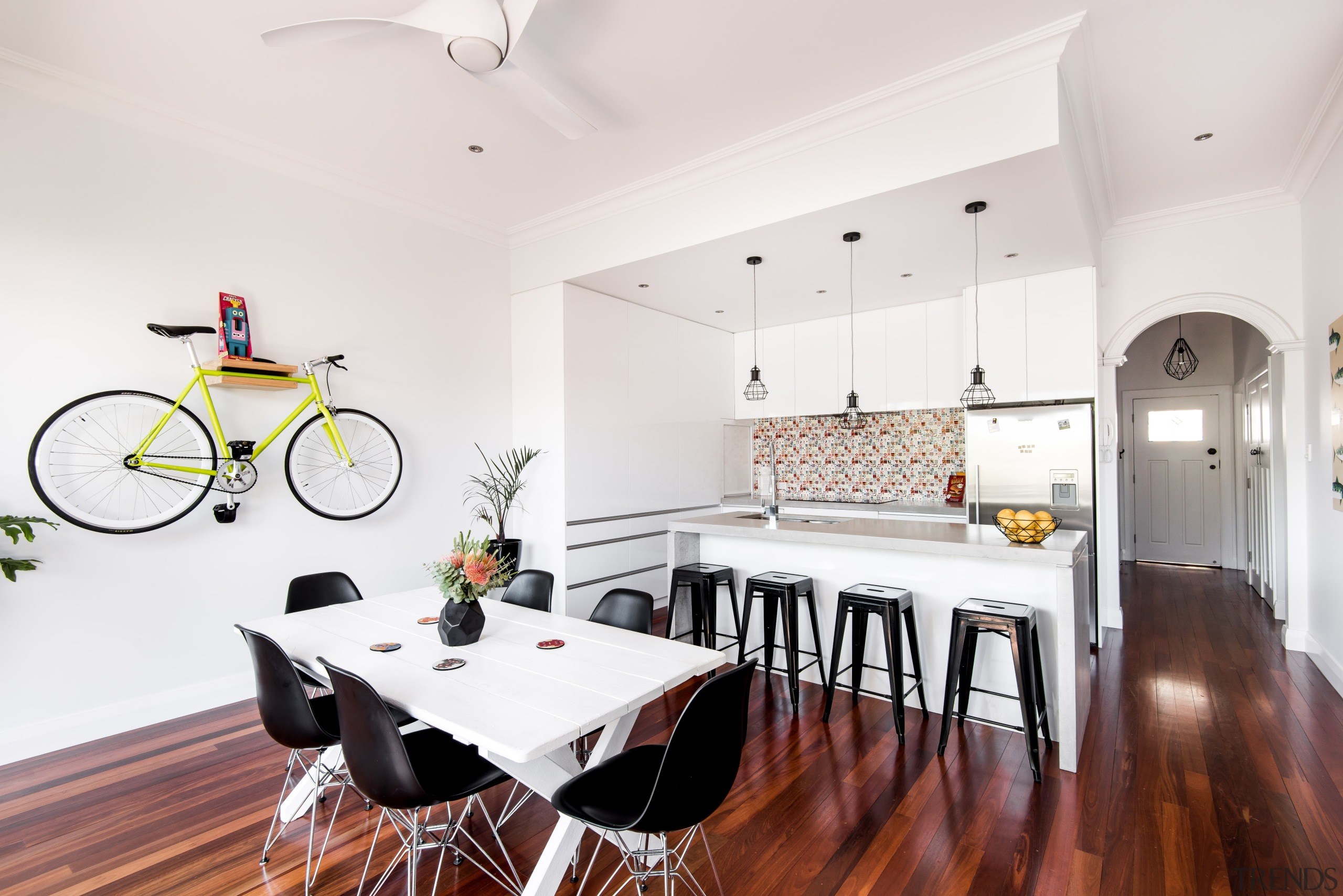 The kitchen as been opened up to the architecture, building, ceiling, design, dining room, floor, flooring, furniture, hardwood, home, house, interior design, kitchen, laminate flooring, property, real estate, room, table, wall, wood, wood flooring, white