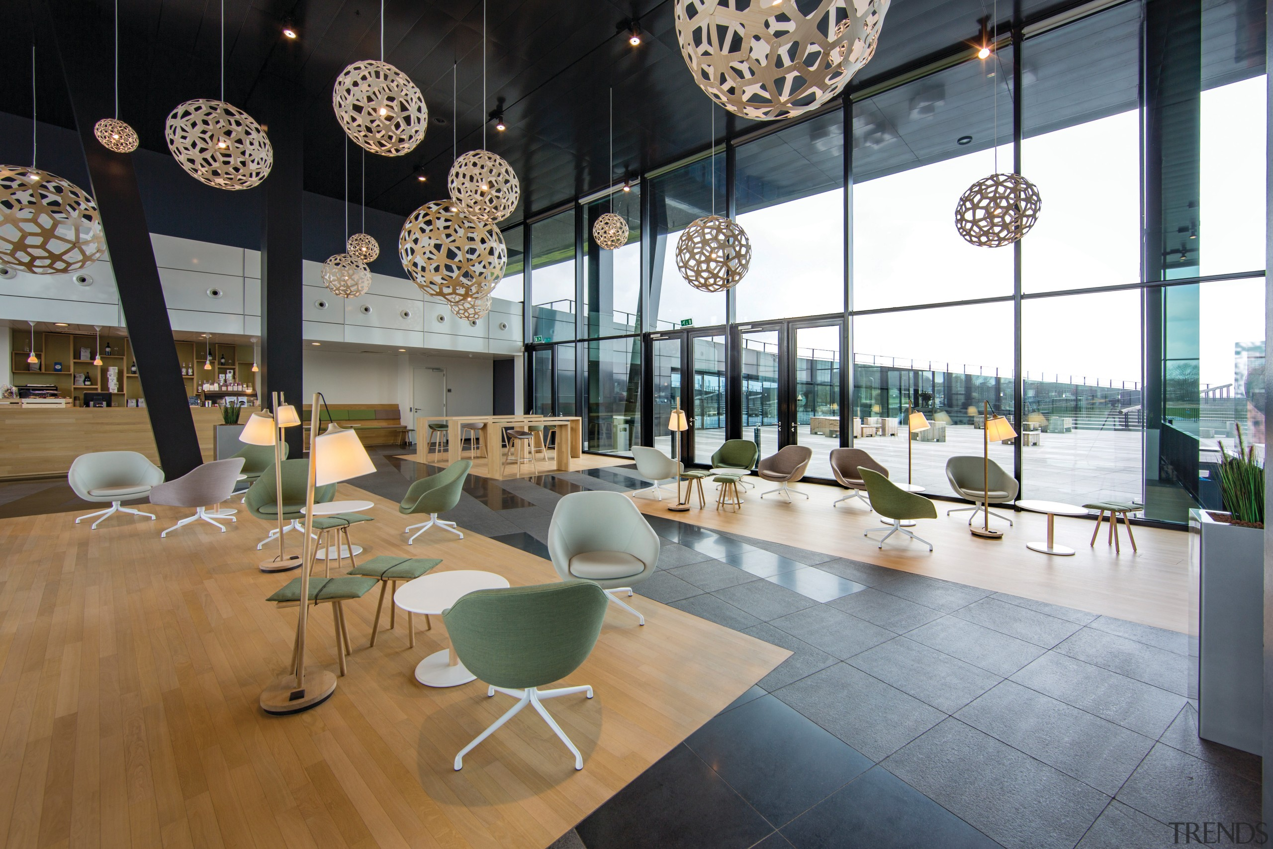 Physical settings that encourage informal or casual interaction architecture, furniture, interior design, lobby, table, gray