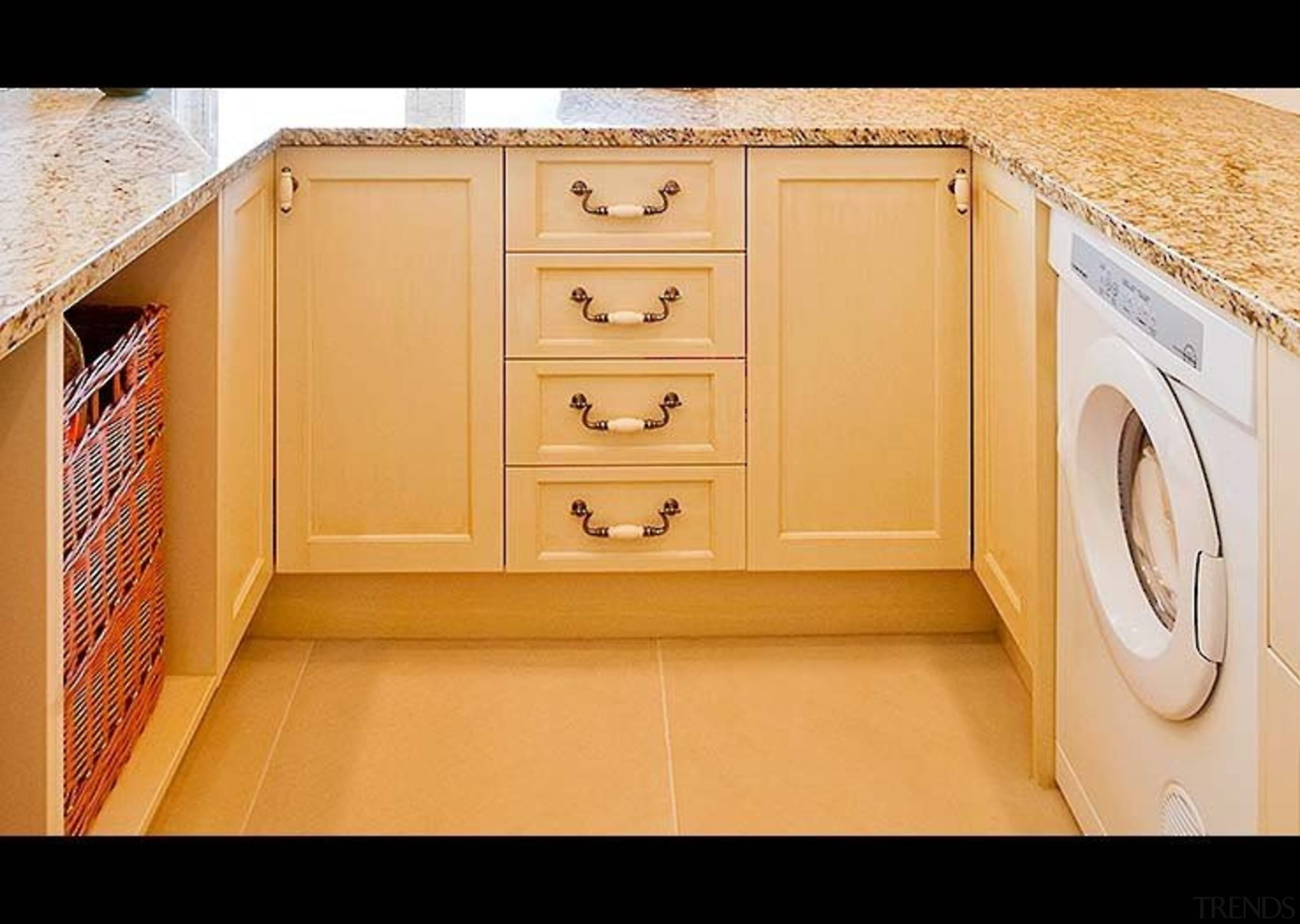 Traditional Laundry - cabinetry | countertop | cupboard cabinetry, countertop, cupboard, drawer, floor, flooring, furniture, hardwood, kitchen, product, property, room, wood, wood stain, orange