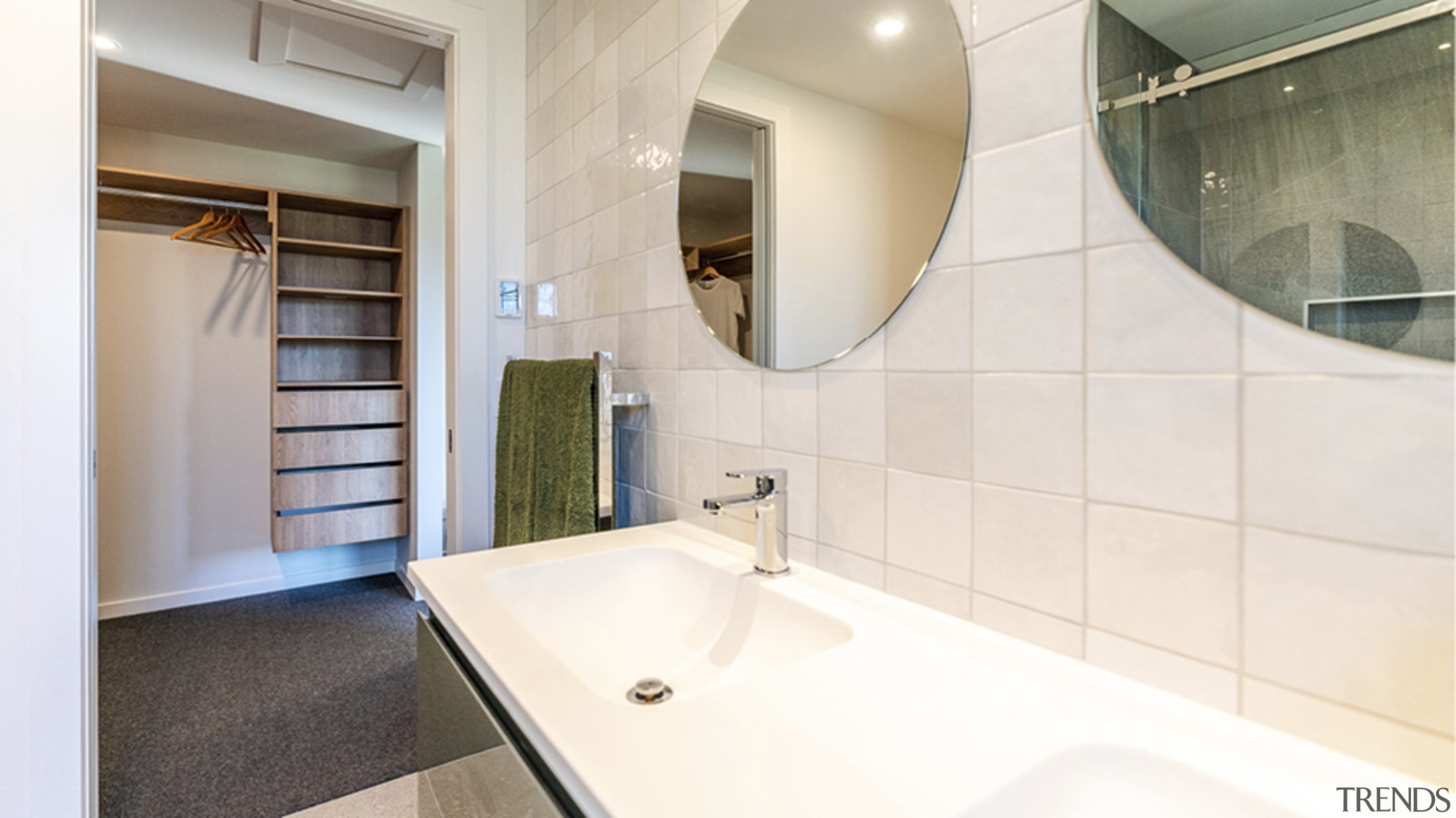 A generous walk-in dressing room complements the spa-like