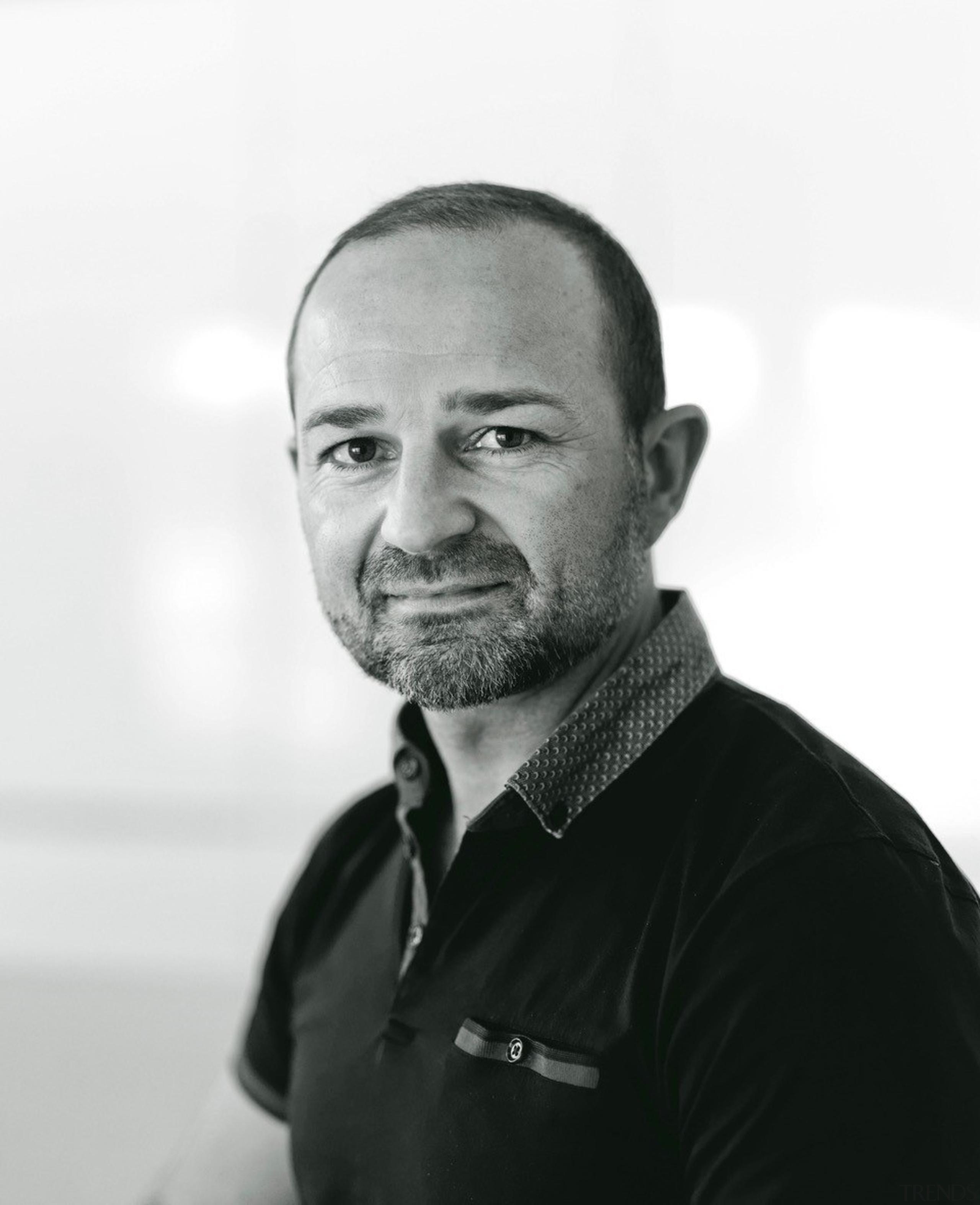 Damian Hannah of German Kitchens designer of UnserHaus white, black