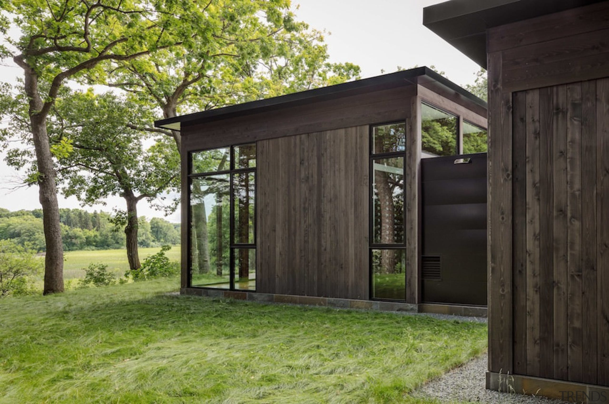 Dark stained timber lines these walls - Dark architecture, facade, home, house, outdoor structure, real estate, shed, black, green