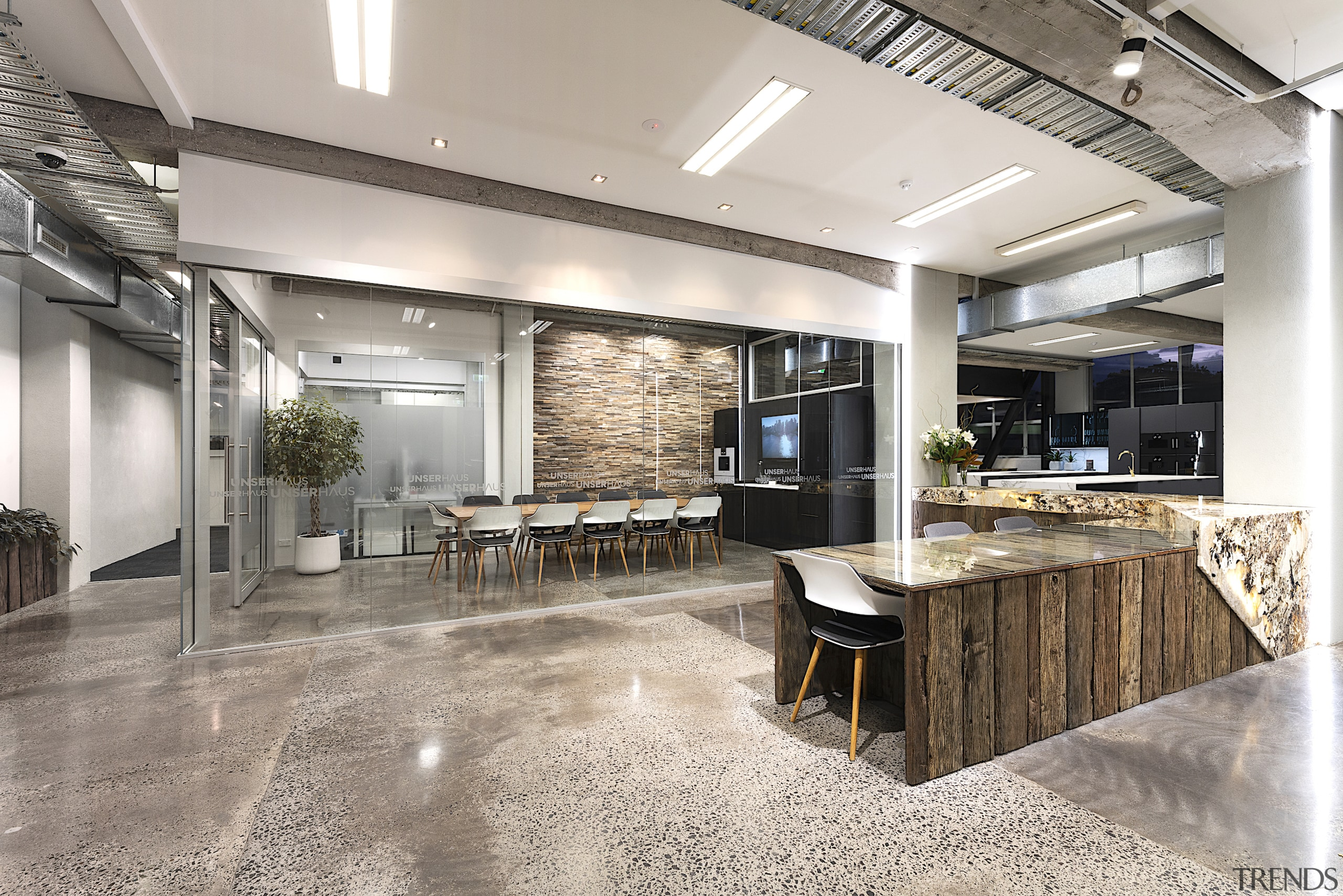 Stone, wood and concrete flooring in between – gray