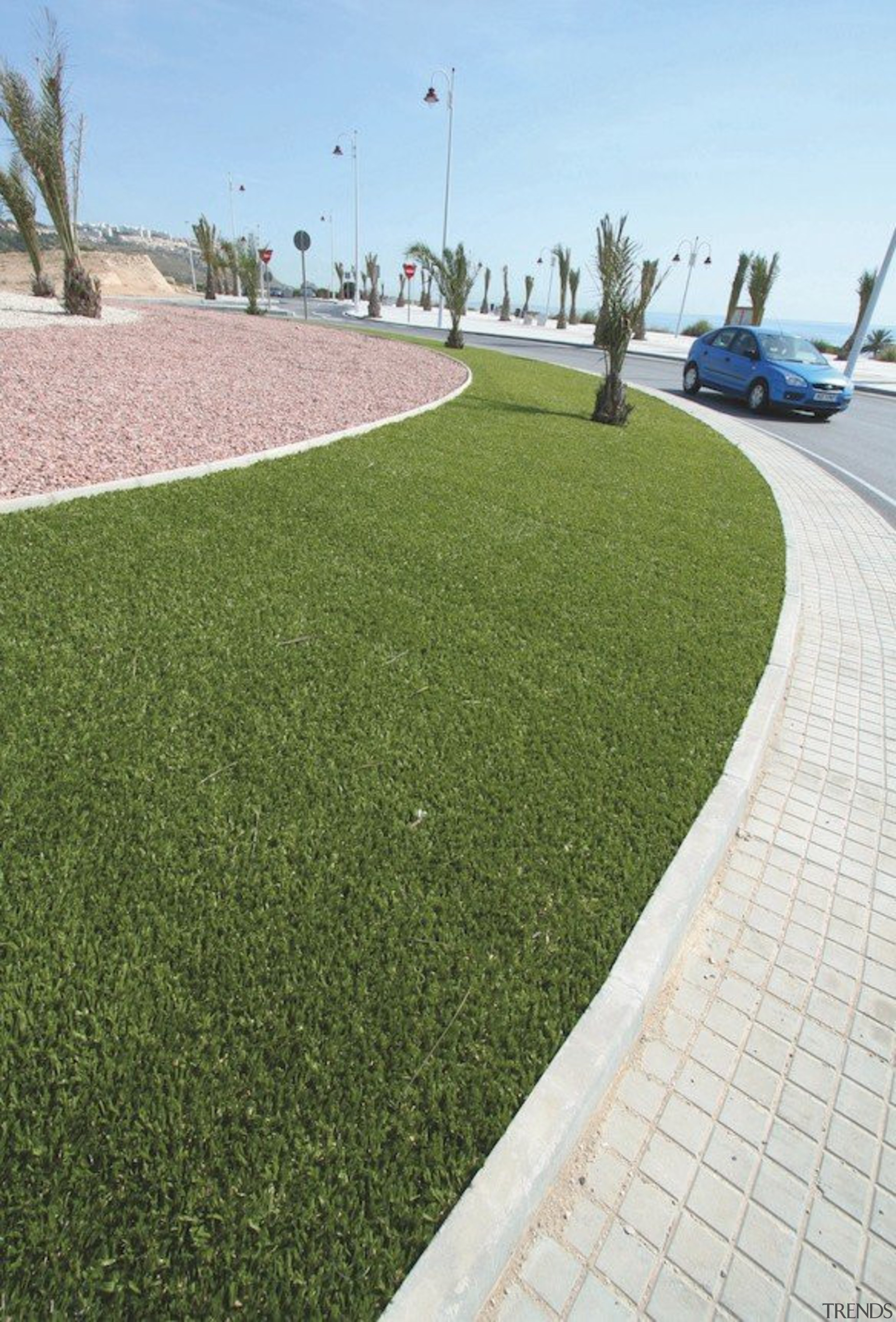 Commercial landscape - artificial turf | asphalt | artificial turf, asphalt, grass, land lot, landscaping, lawn, plant, road surface, walkway, brown, white