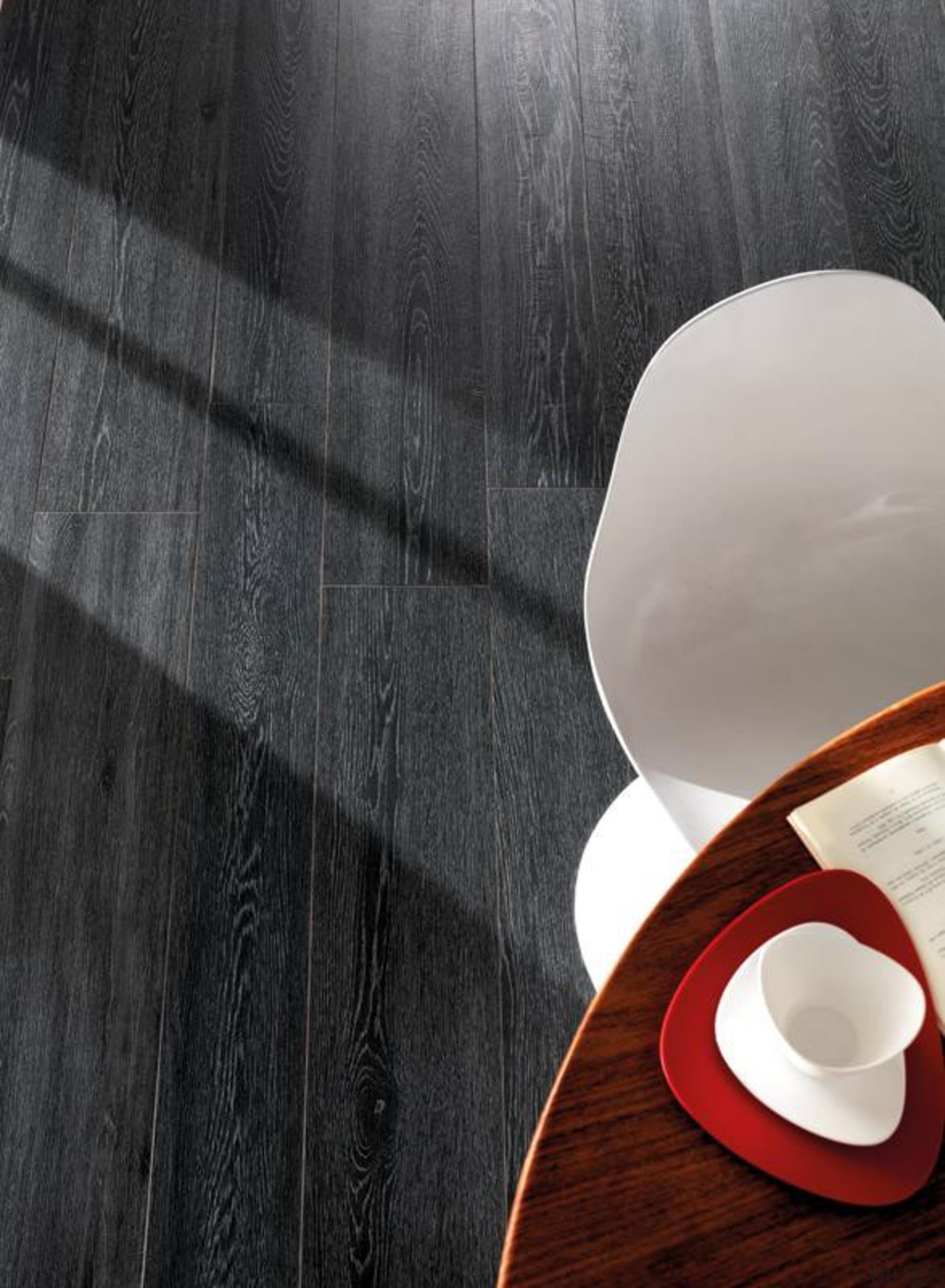 Bioplank oak lava interior wood look floor tiles. cup, floor, flooring, product design, still life photography, black, gray