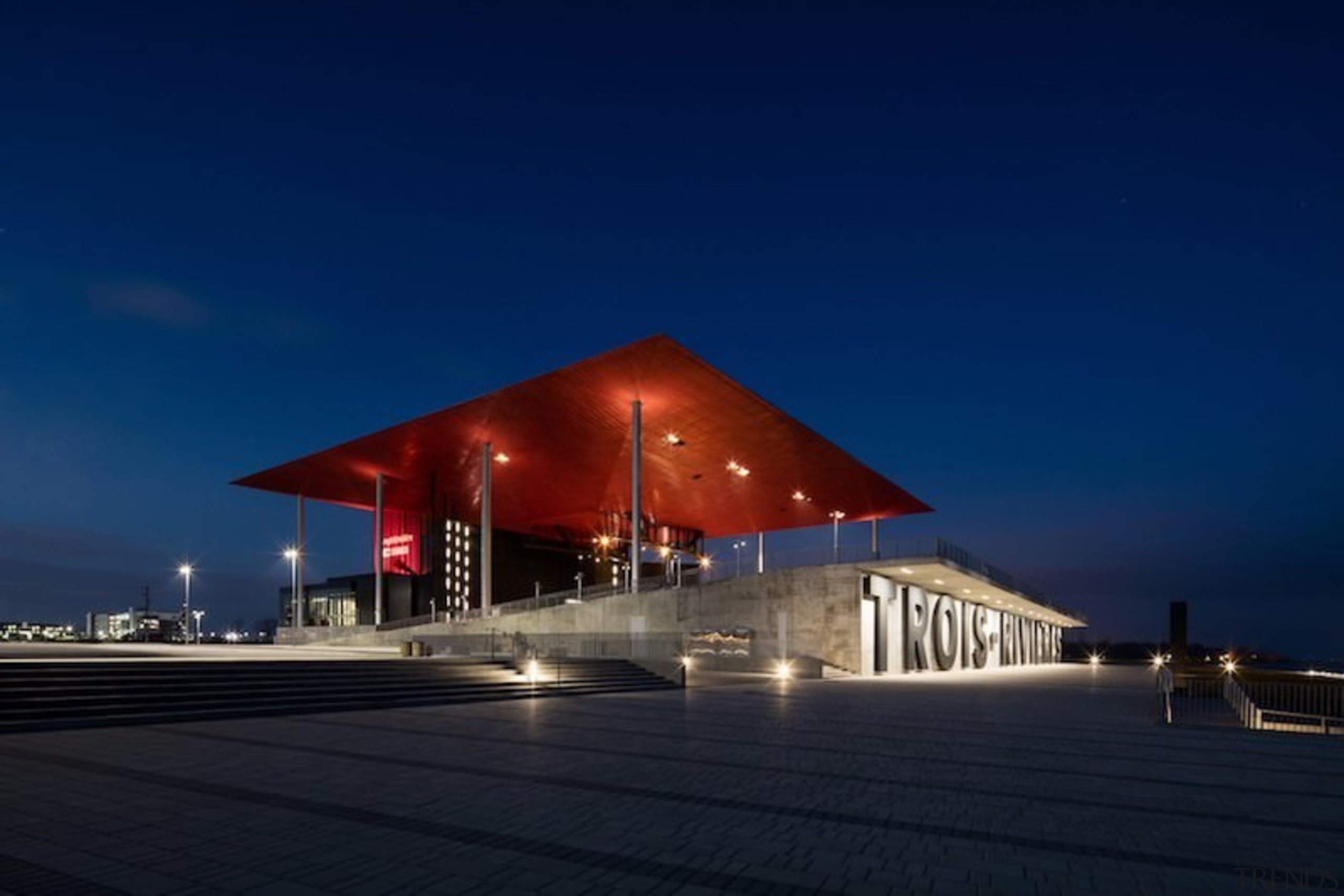 The roof is suspended high above the amphitheatre architecture, building, corporate headquarters, evening, fixed link, lighting, opera house, sky, structure, tourist attraction, blue, black