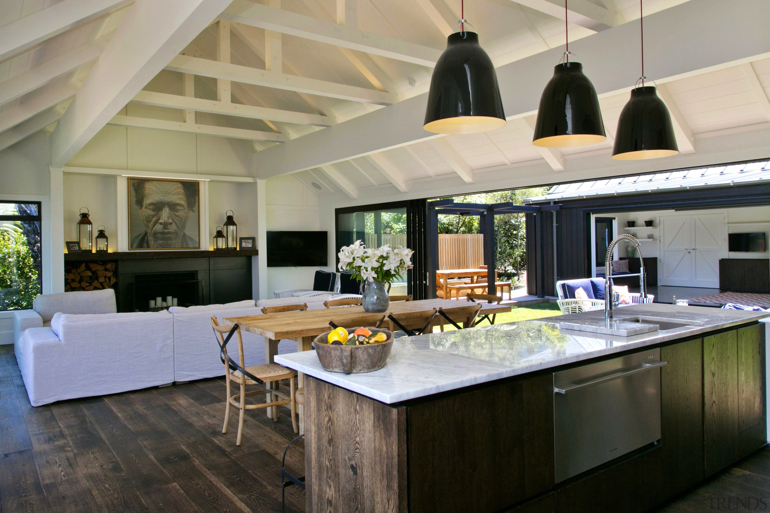 Features of this kitchen and living room space countertop, interior design, kitchen, living room, real estate, gray, black