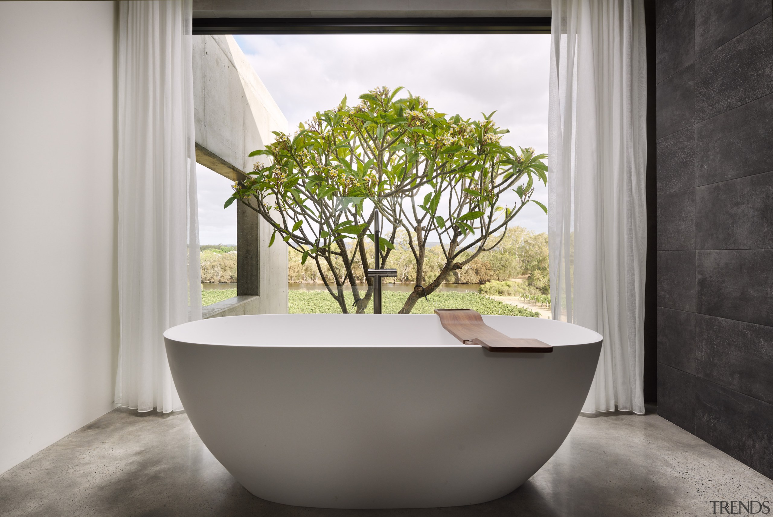 The freestanding bath is centred on an amazing