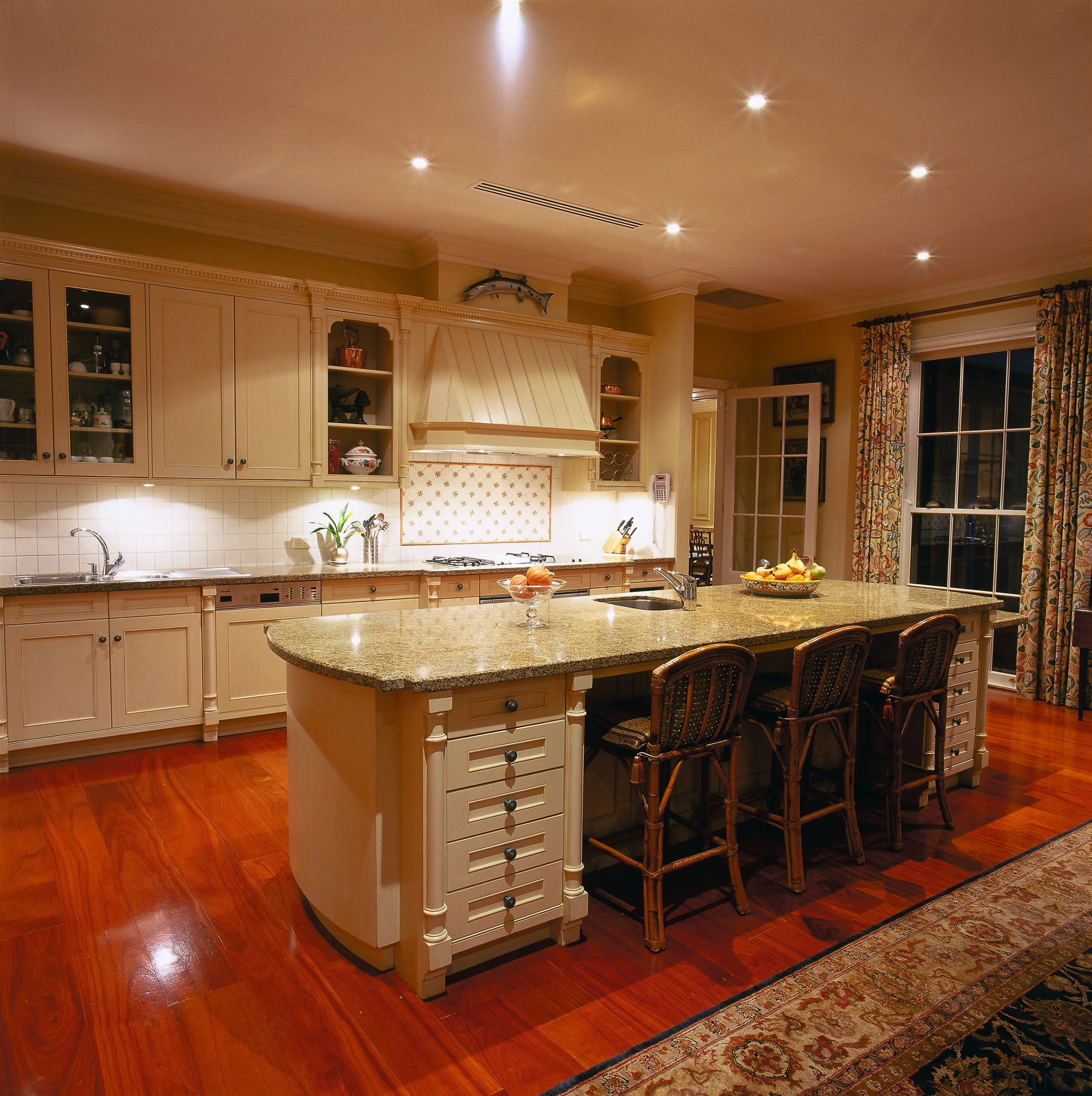 View of the kitchen - View of the cabinetry, ceiling, countertop, cuisine classique, floor, flooring, hardwood, home, interior design, kitchen, real estate, room, table, under cabinet lighting, wood, wood flooring, brown