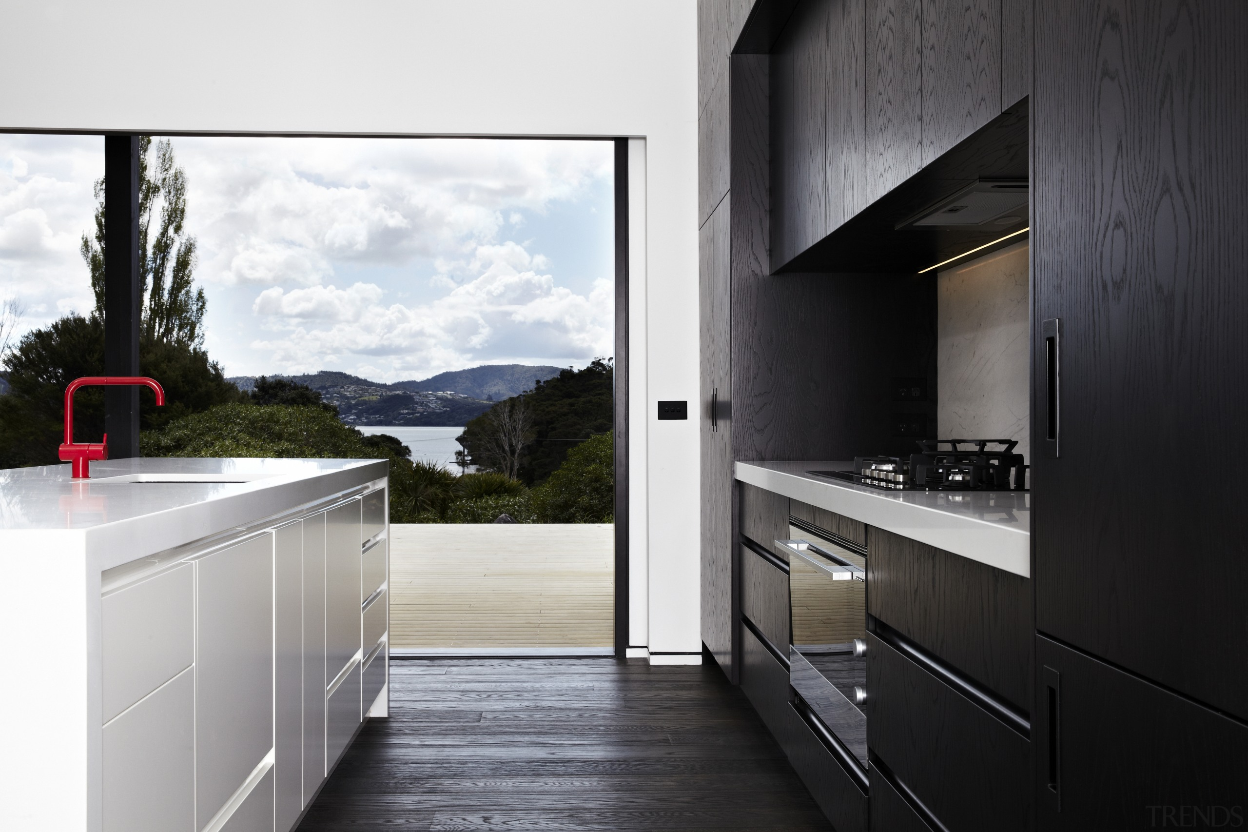 This kitchen, in a modern beach house designed architecture, countertop, home, home appliance, house, interior design, kitchen, real estate, black, white