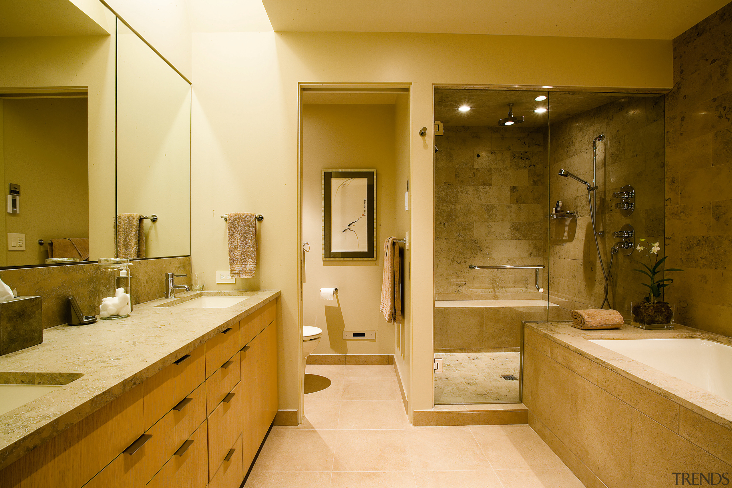 view of the master bathroom featuring limetsone surfaces, bathroom, estate, home, interior design, room, suite, brown, orange