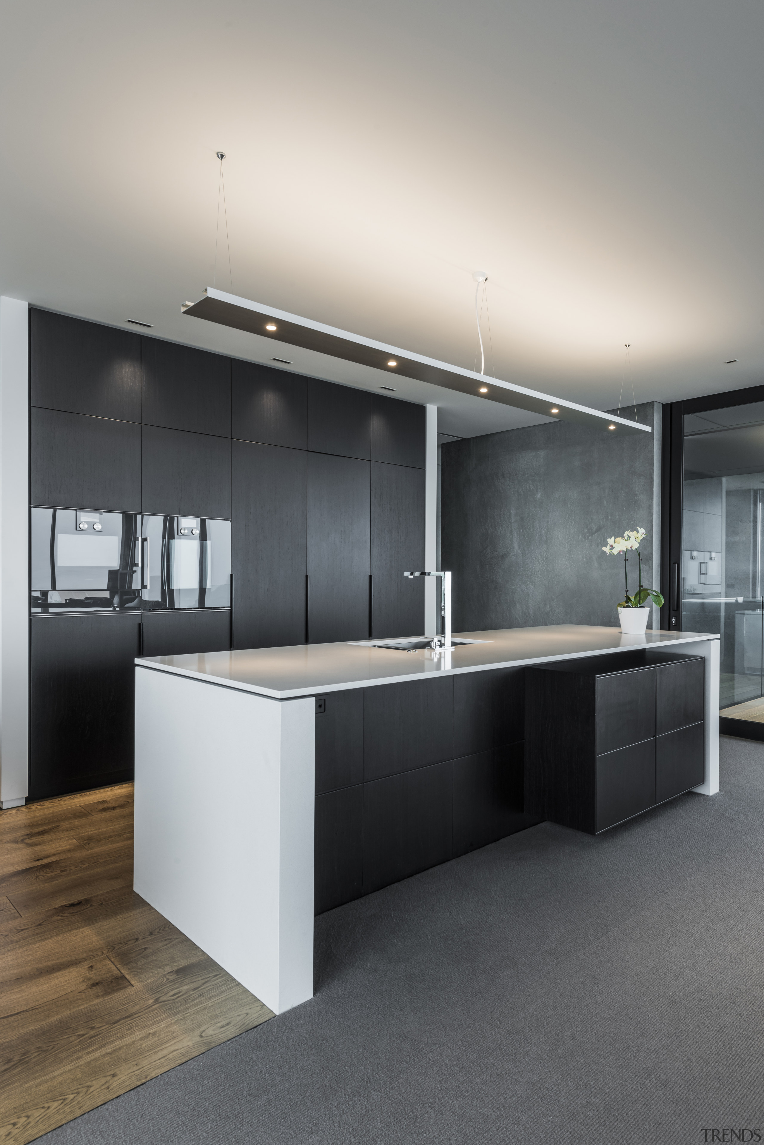 This kitchen by designer Davinia Sutton achieves a architecture, countertop, floor, interior design, kitchen, sink, gray