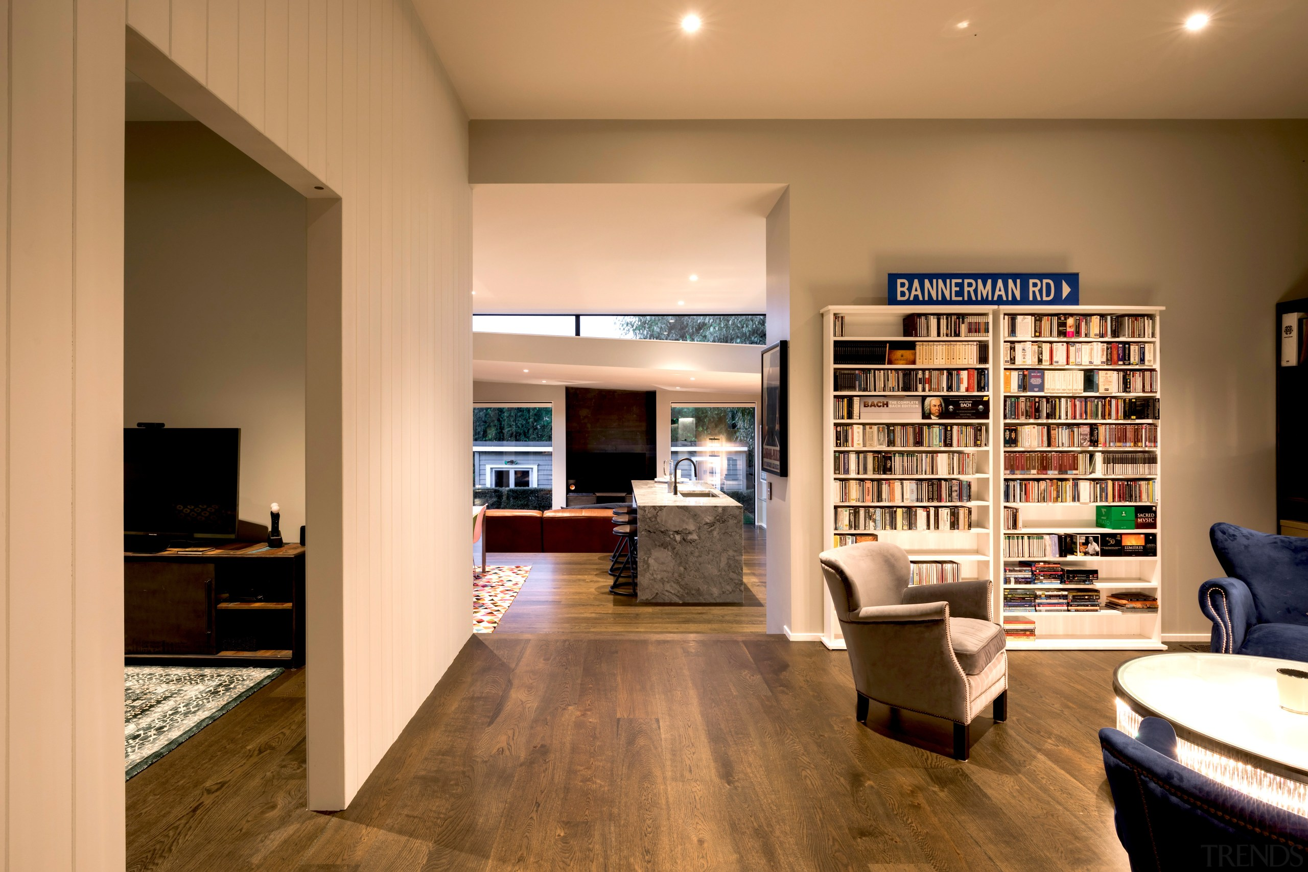 Modern extension celebrates contrast with existing traditional villa architecture, building, cabinetry, ceiling, floor, flooring, furniture, hardwood, home, house, interior design, laminate flooring, living room, property, real estate, room, shelf, shelving, wall, wood, wood flooring, orange, brown