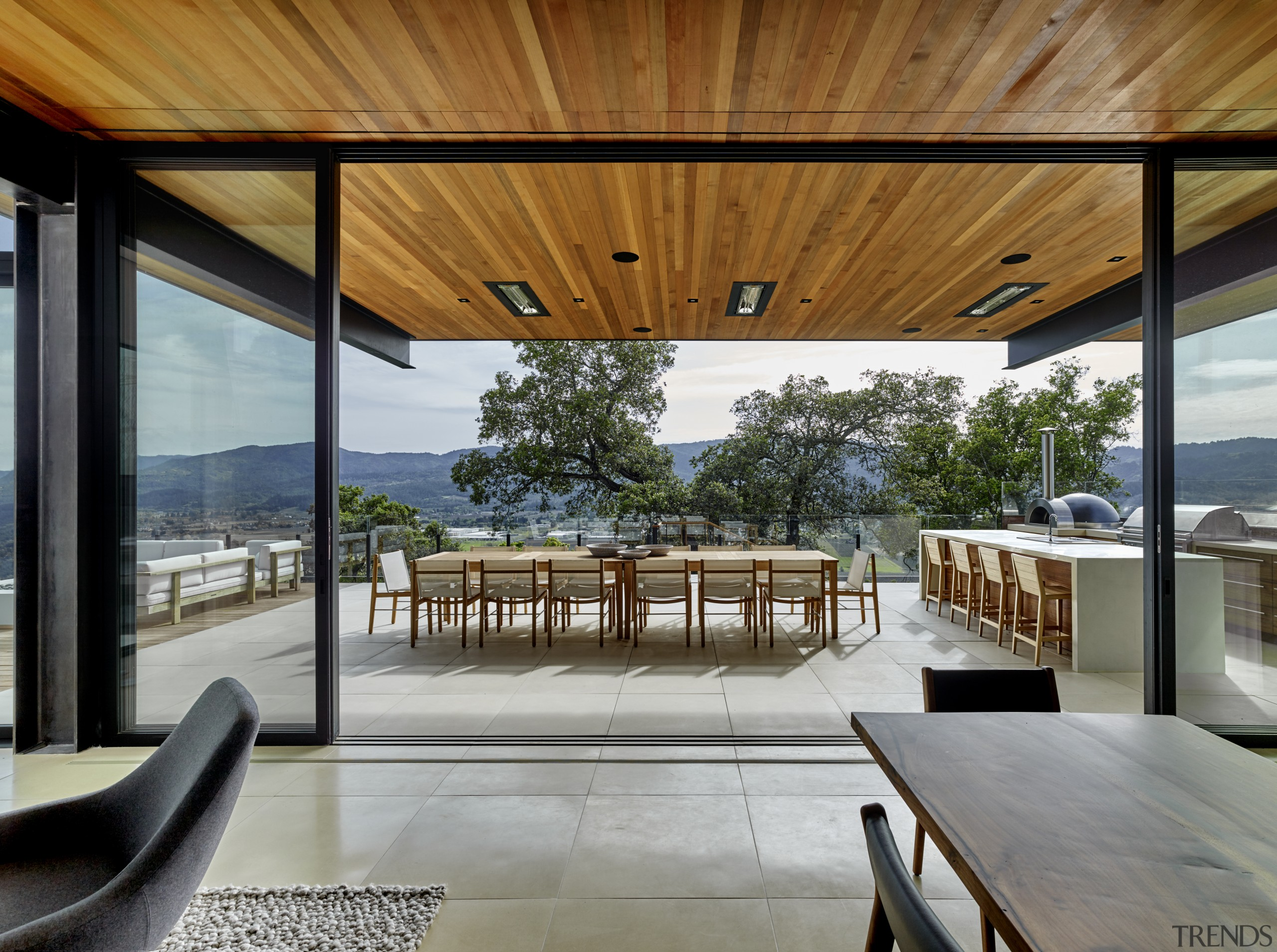Views across the valley predominate in the living architecture, deck, design, floor, tiles, furniture, home, house, interior design, living room, patio, porch, shade, table, window, wood, tiles,  floor, de Vito Design + construction