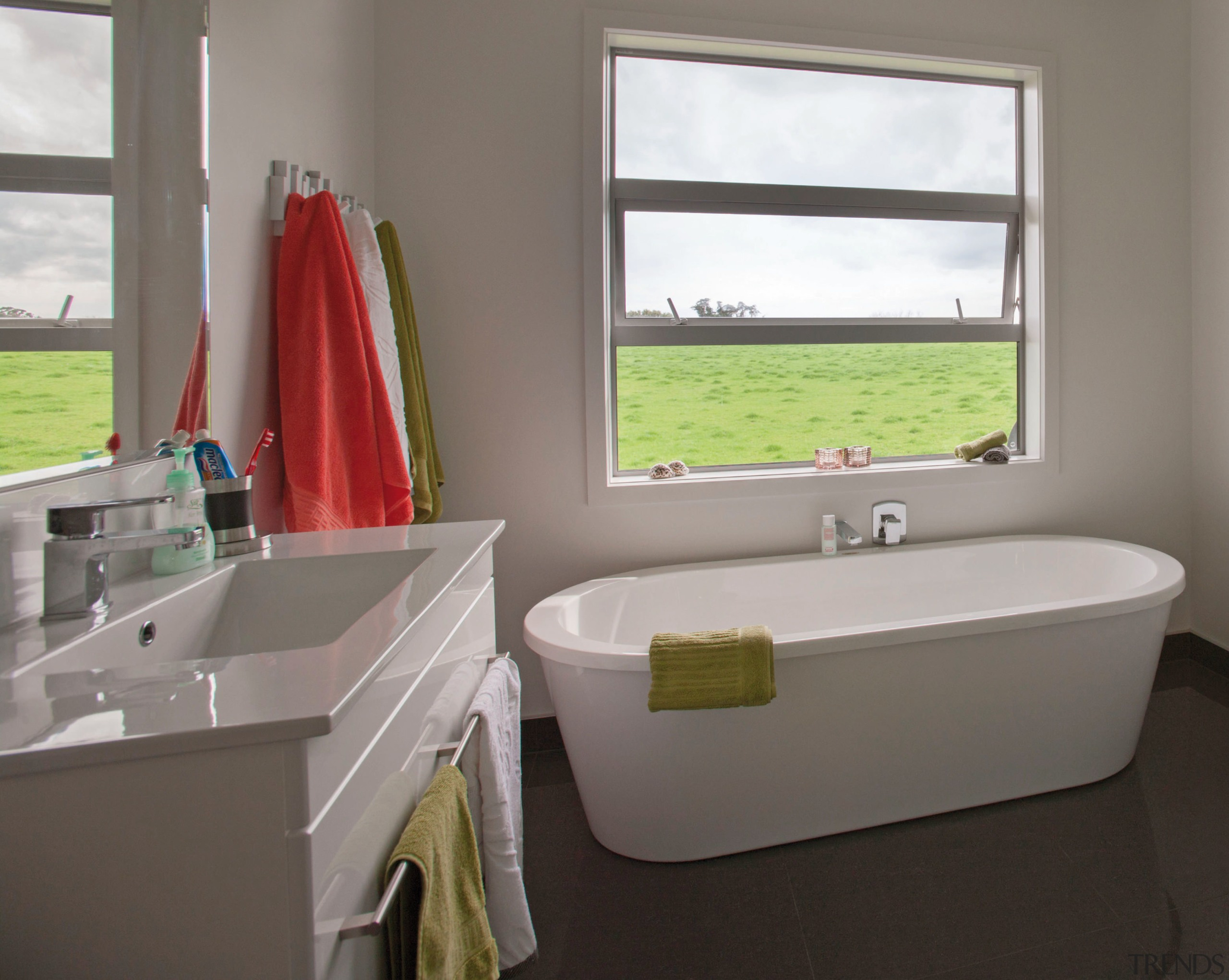 This master suite in a GJ Gardner Homes bathroom, bathroom accessory, interior design, plumbing fixture, room, sink, window, gray