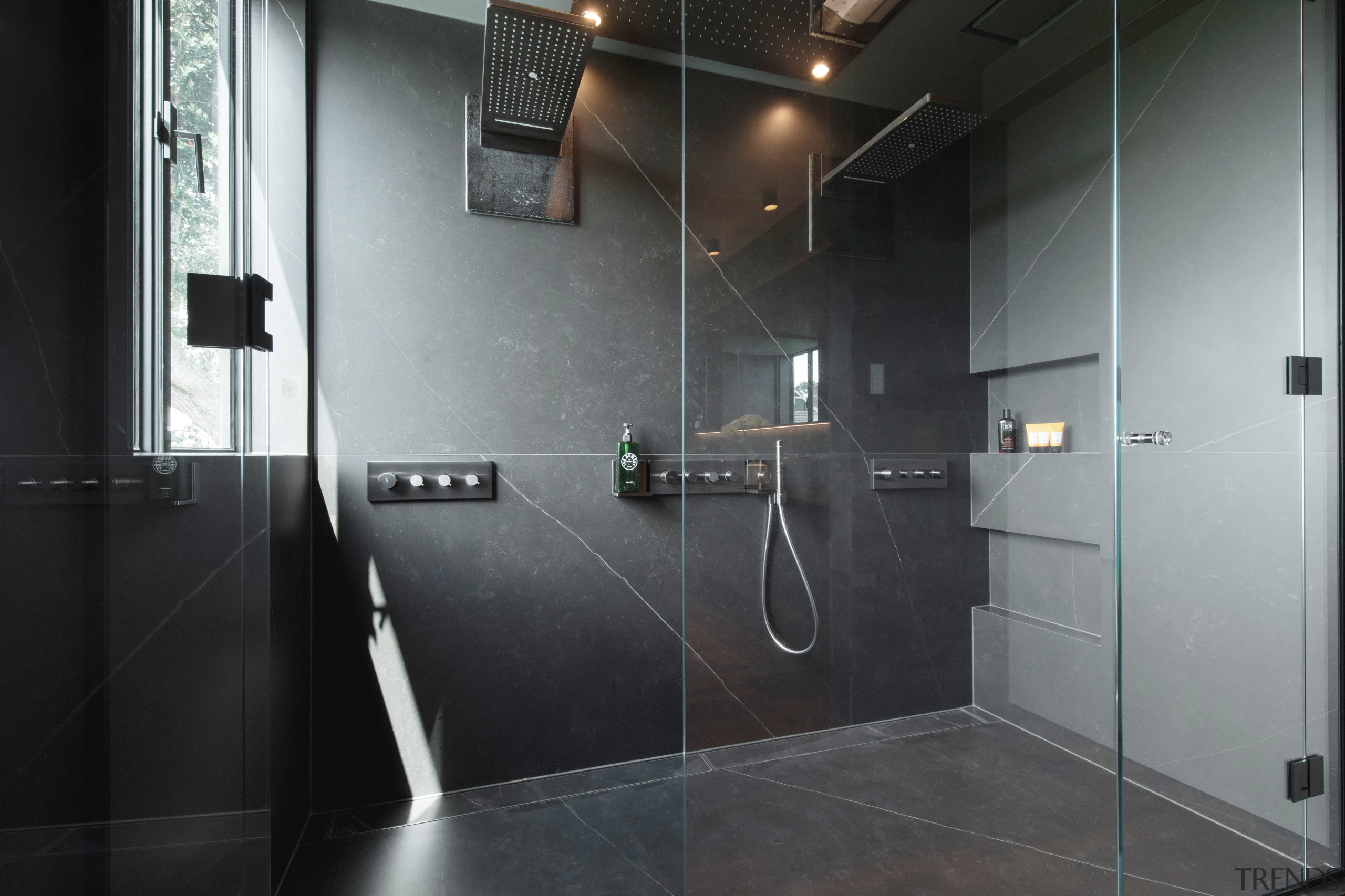 The double shower is equipped with overhead Axor