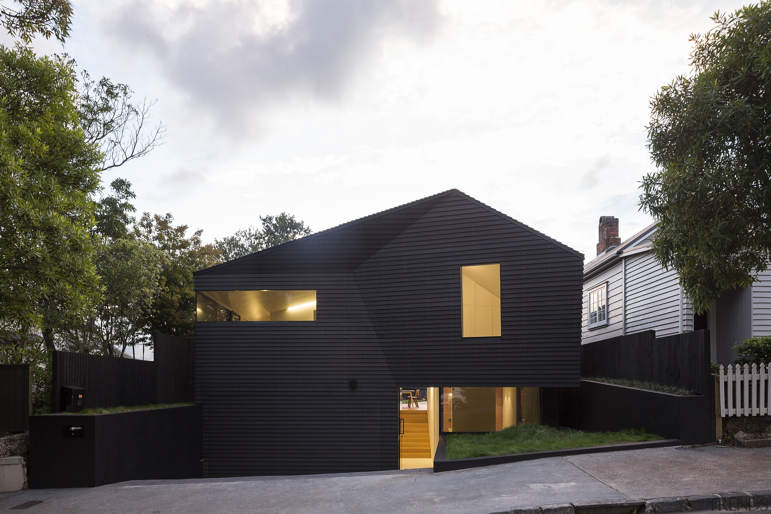 Black walls and angled planes create a distinctive architecture, building, cottage, facade, home, house, property, real estate, residential area, siding, black, white